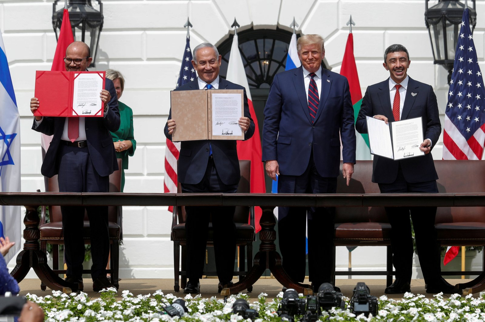 (From L to R) Bahrain's Foreign Minister Abdullatif al-Zayani, Israel's Prime Minister Benjamin Netanyahu, U.S. President Donald Trump and United Arab Emirates (UAE) Foreign Minister Abdullah bin Zayed in the signing ceremony of the Abraham Accords, on the South Lawn of the White House in Washington, D.C., Sept. 15, 2020. (Reuters Photo)