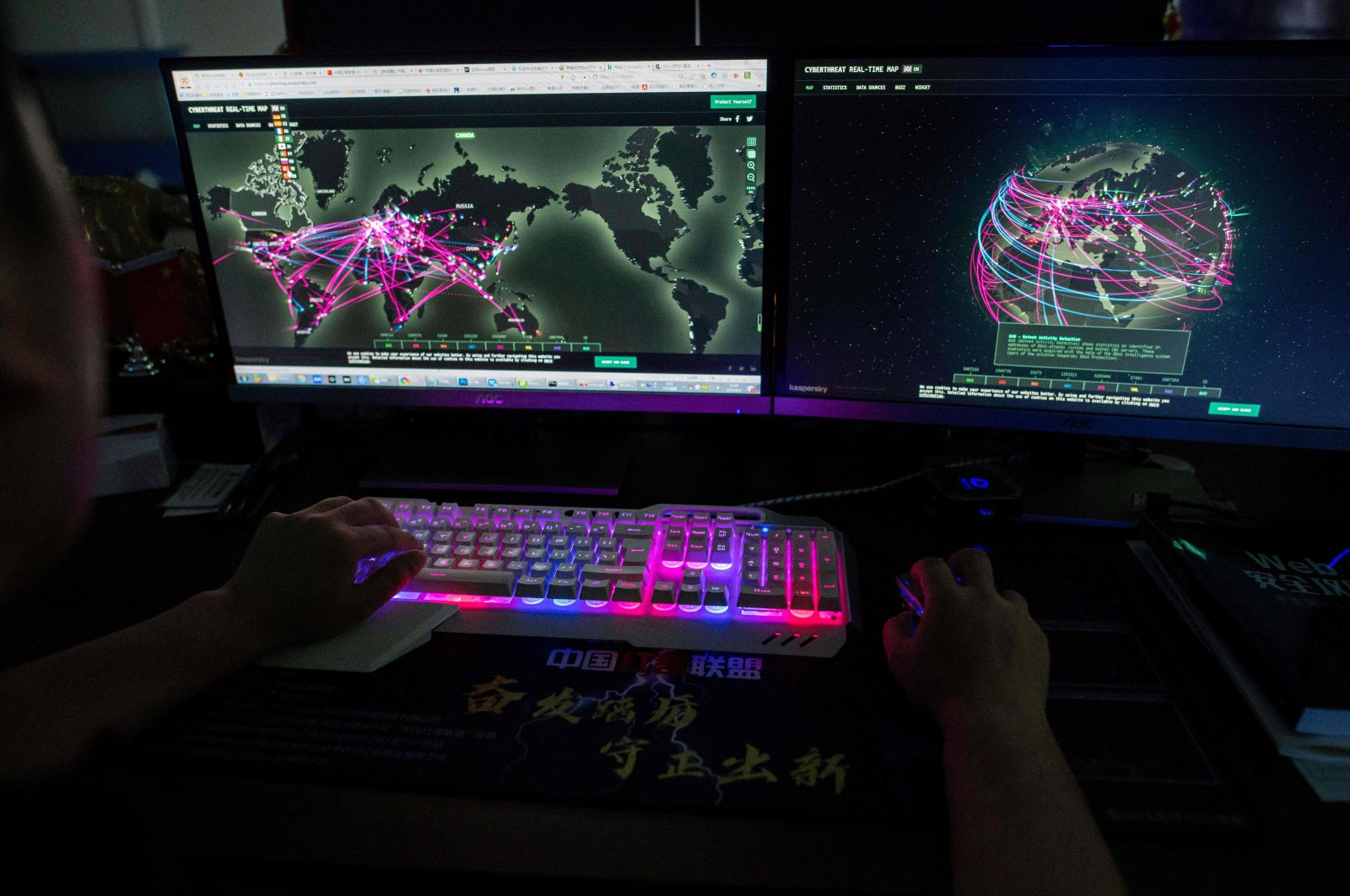 Prince, a member of the hacking group Red Hacker Alliance who refused to give his real name, using a website that monitors global cyberattacks on his computer at their office in Dongguan, southern Guangdong province, China, Aug. 4, 2020. (AFP File Photo)