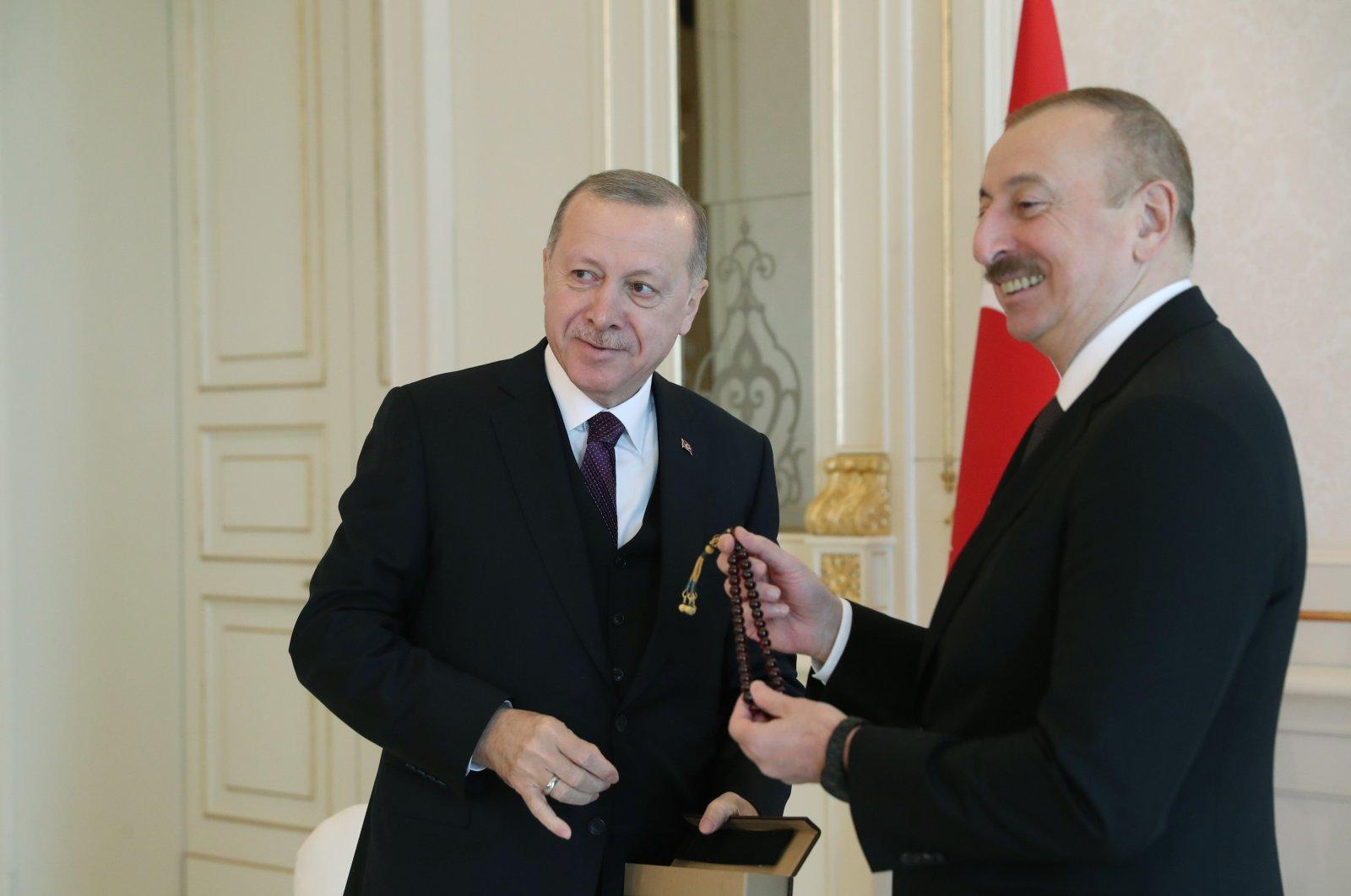 President Recep Tayyip Erdoğan (L) and Azerbaijani President Ilham Aliyev during a meeting in Baku, Feb. 26, 2020. (AA Photo)