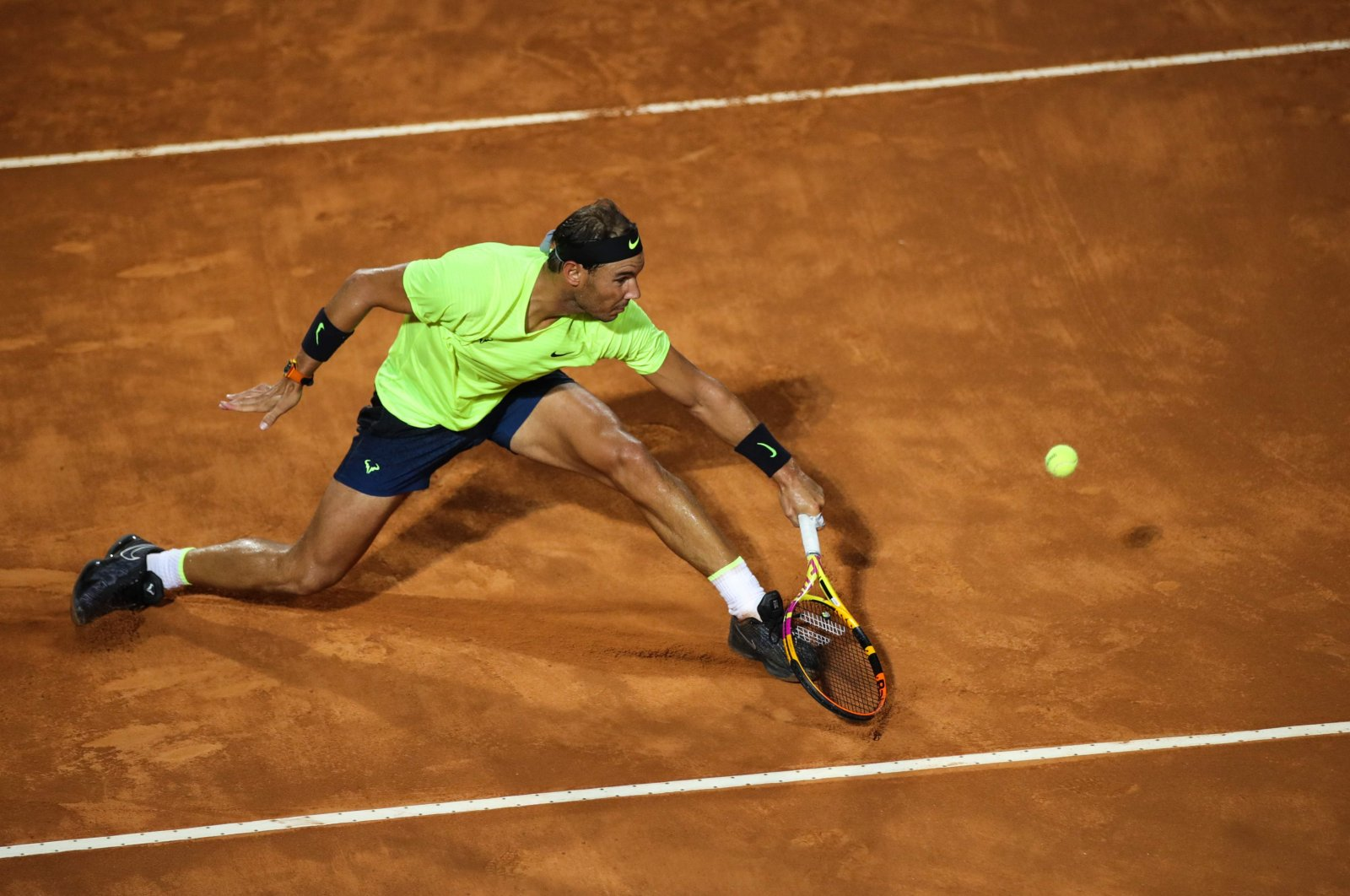 Rafael Nadal plays a backhand during an Italian Open match in Rome, Italy, Sept. 19, 2020. (AFP Photo)