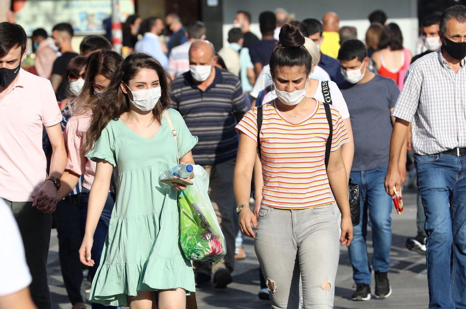 People wearing face masks walk along a street in the capital Ankara, Turkey, Sept. 18, 2020. (AFP Photo)