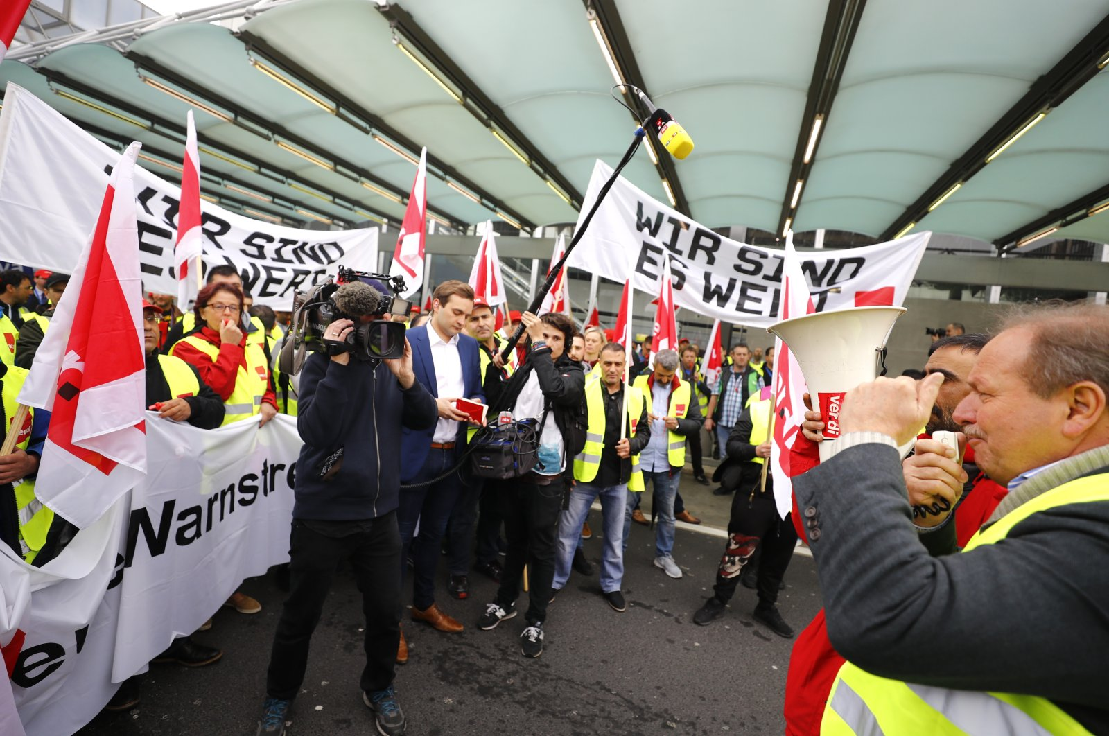 German public sector workers union Verdi leader Frank Bsirske (R) speaks during the strike at the airport in demand for higher wages in Frankfurt, Germany, April 10, 2018. (Reuters Photo)