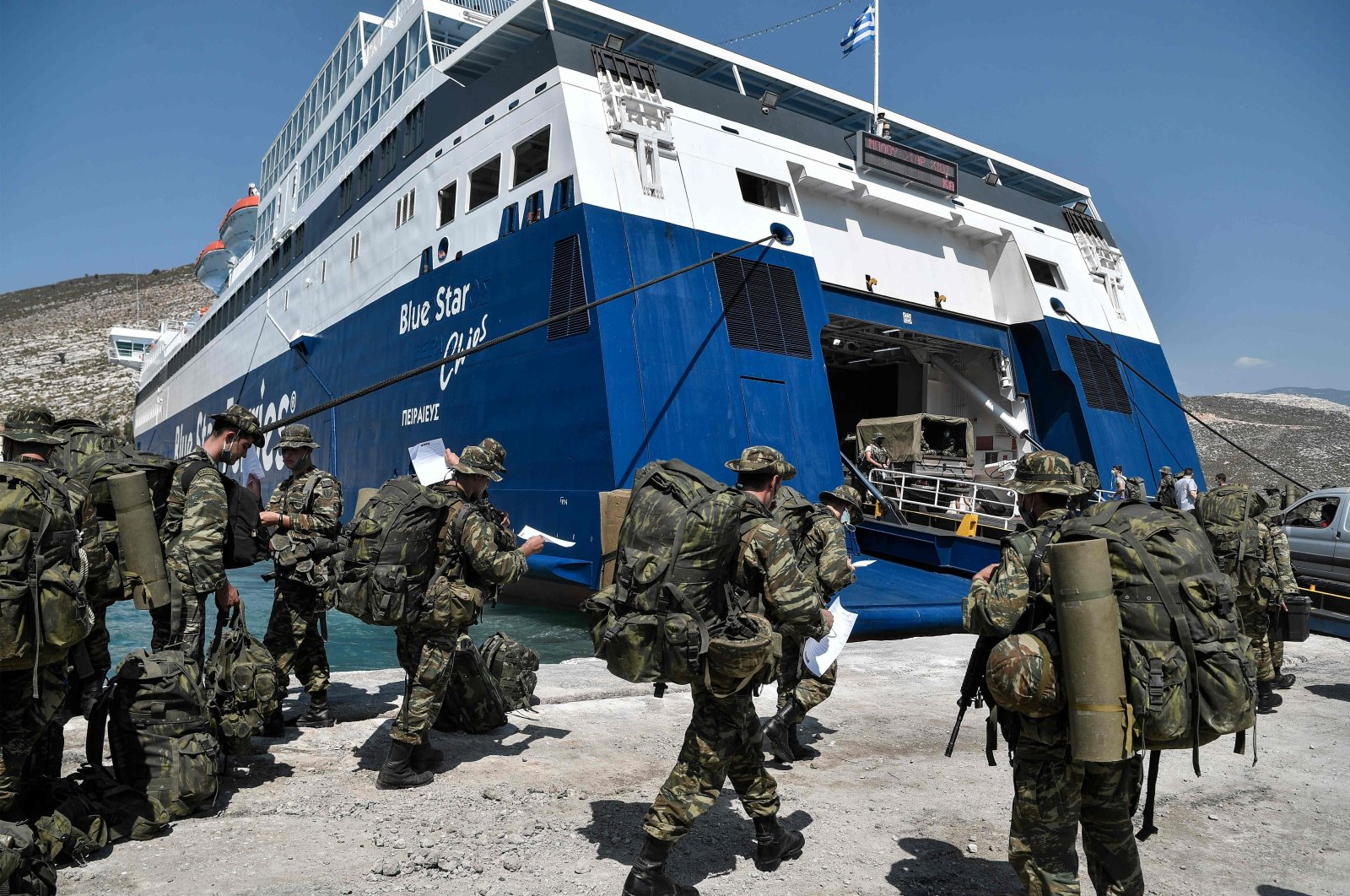 Greek soldiers prepare to board a ferry at the port of the tiny Greek island of Kastellorizo (Megisti-Meis), the most southeastern inhabited Greek island in the Dodecanese, situated two kilometers off the south coast of Turkey. (AFP Photo)