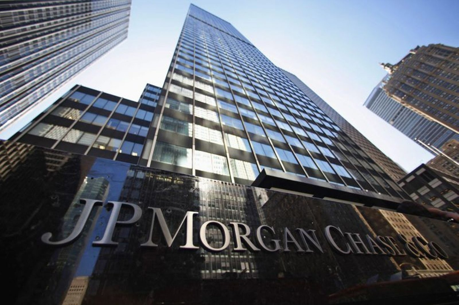 A sign outside the headquarters of JP Morgan Chase & Co in New York, in this September 19, 2013 file photo. For years, the banking giant aided one of the world's biggest Ponzi schemers, Bernie Madoff. (Reuters Photo)