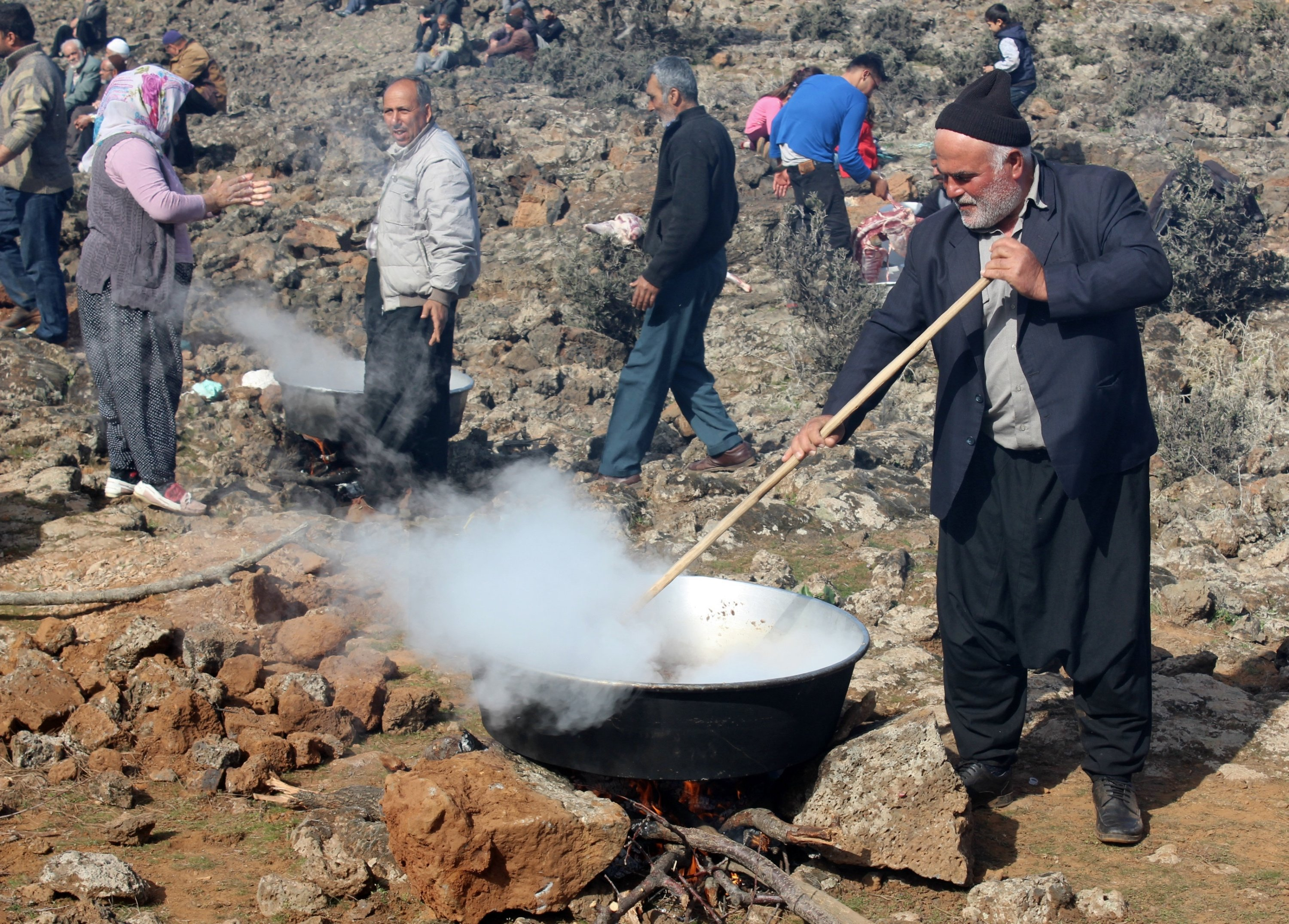 A local stirs a cauldron of food after a rain praying ritual in Hatay's Hassa district in southern Turkey, Feb. 27, 2020. (AA Photo)