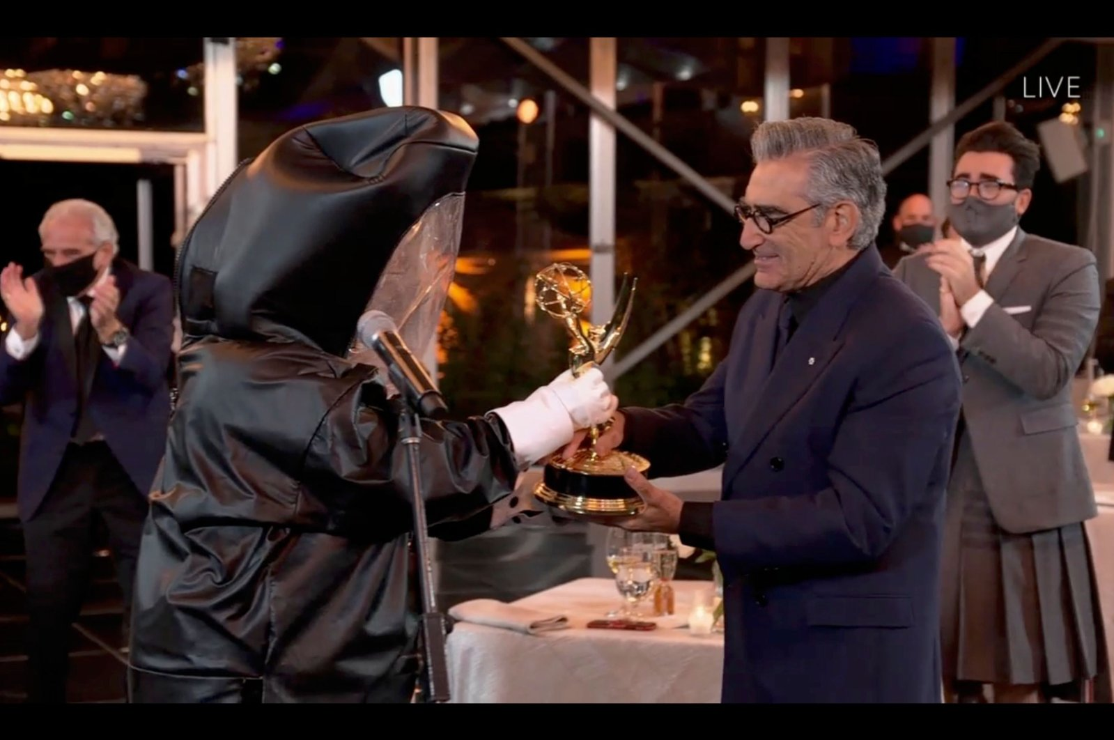 "A handout photo made available by the Academy of Television Arts & Sciences shows Eugene Levy accepting the outstanding lead actor in a comedy series award for ""Schitt's Creek"" during the 72nd annual Primetime Emmy Awards ceremony in Los Angeles, California, U.S., Sept. 20, 2020. (EPA Photo)"