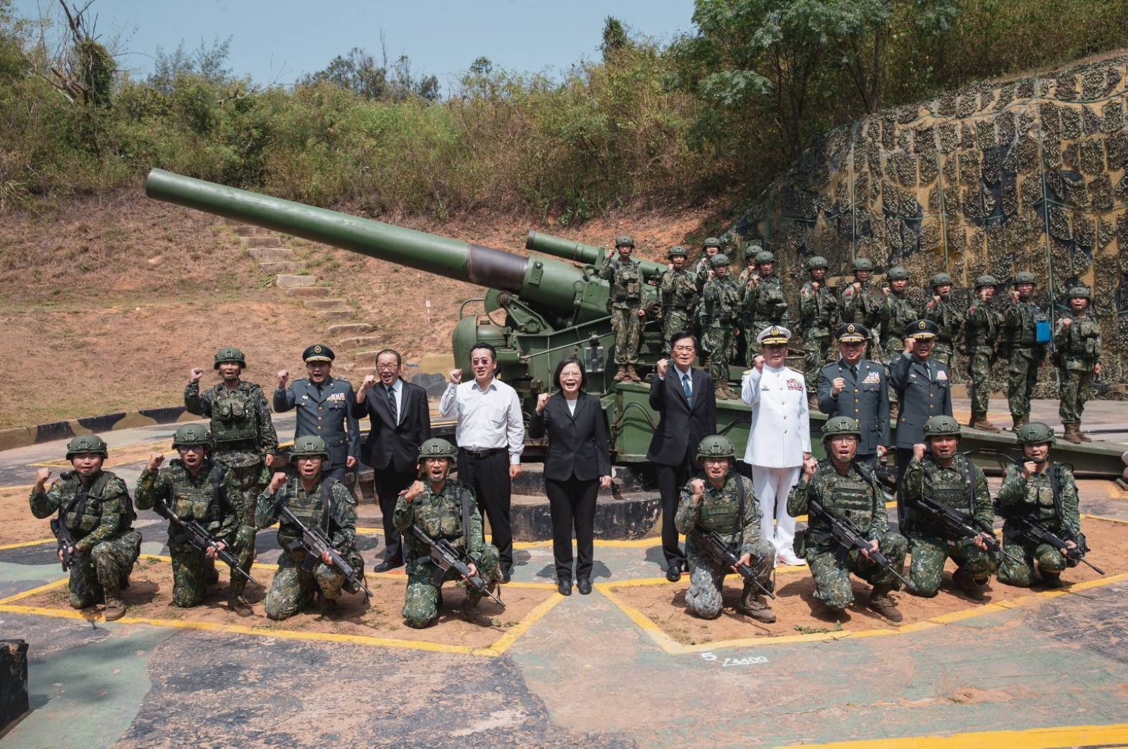 A handout photo made available by the Taiwan Presidential Office, shows Taiwan President Tsai Ing-wen (C) pose for a photograph next to military personnel during her visit to attend the 62nd anniversary of the Second Taiwan Strait crisis in Kinmen, Taiwan, Aug. 23, 2020. (EPA Photo)
