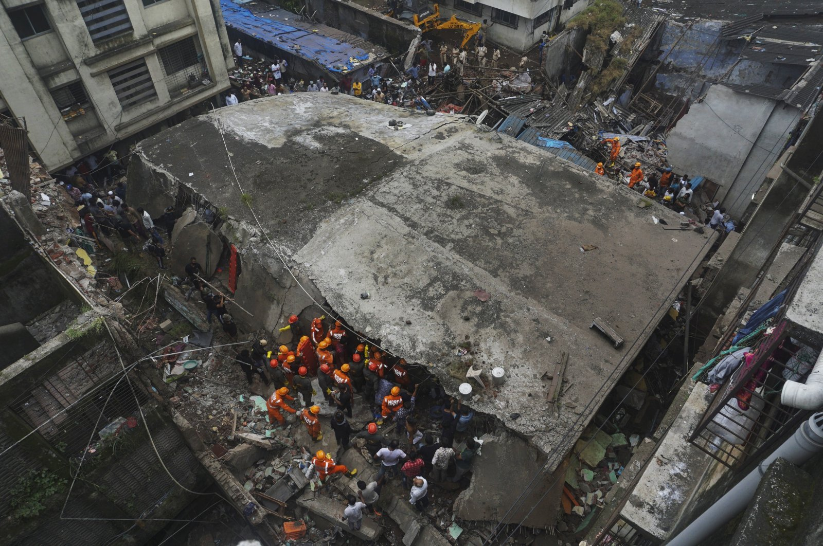 Rescuers look for survivors after a residential building collapsed in Bhiwandi in Thane district, a suburb of Mumbai, India, Sept. 21, 2020. (AP Photo)