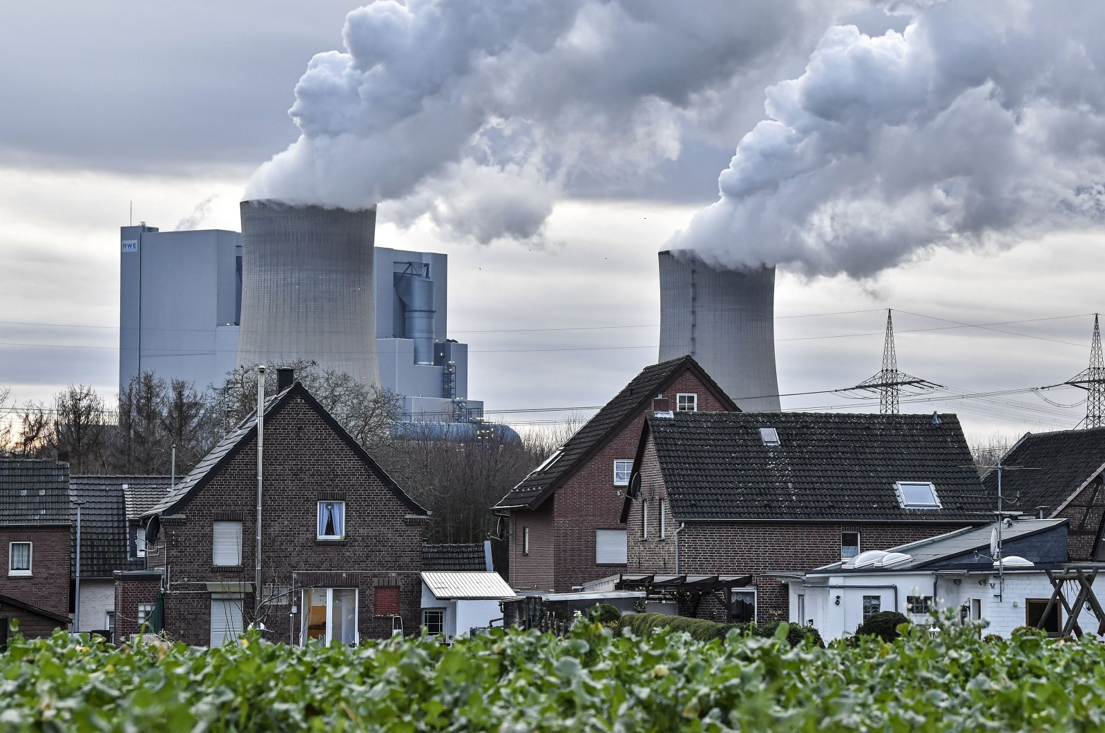 The RWE lignite-fired power station releases steam in Bergheim, Germany, Jan. 13, 2020. (AP Photo)
