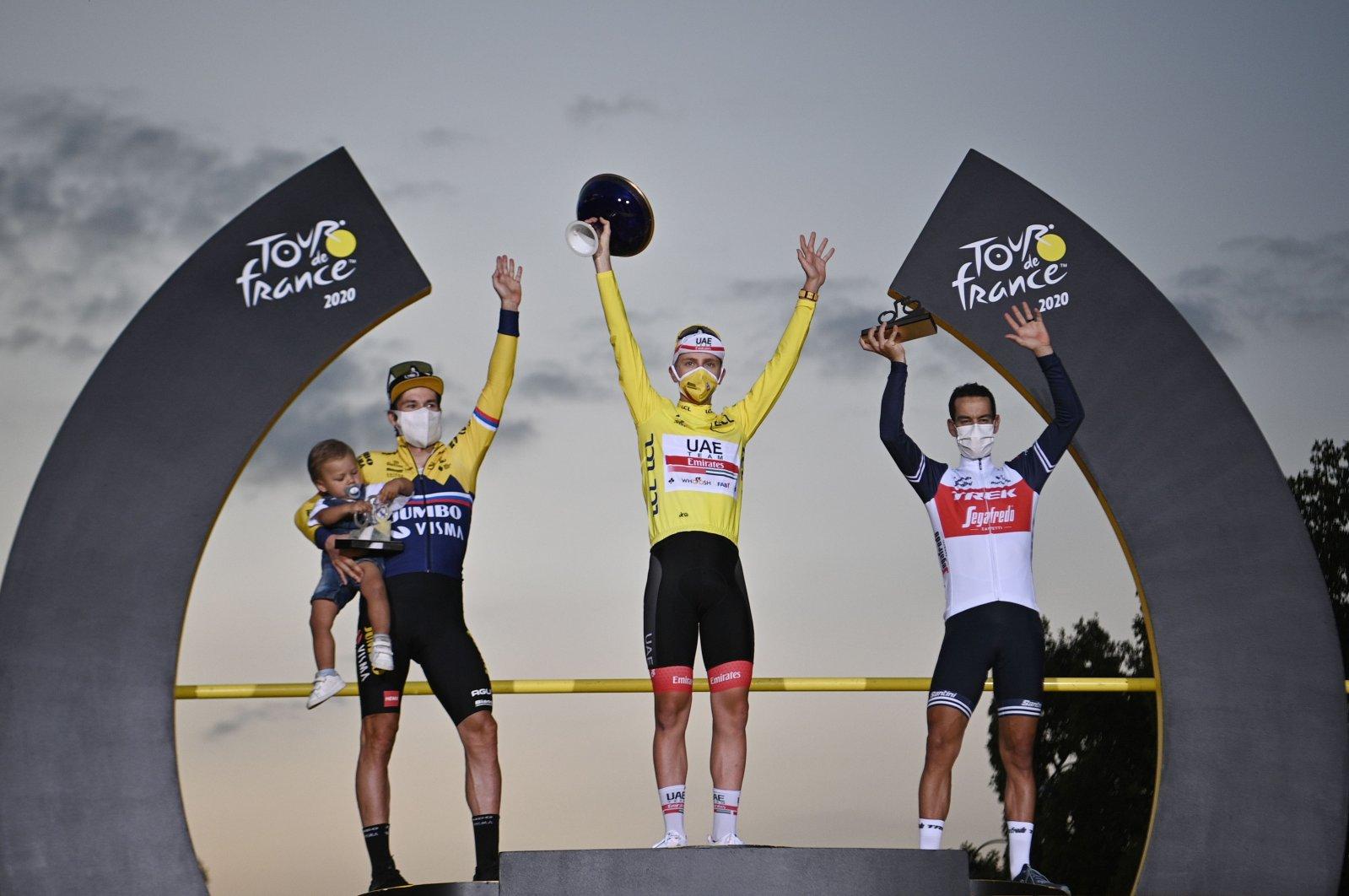 Team UAE rider Tadej Pogacar (C) celebrates on the podium between Team Jumbo rider Primoz Roglic (L) and Team Trek rider Richie Porte after winning the 107th edition of the Tour de France cycling race, Paris, France, Sept. 20, 2020. (AFP Photo)