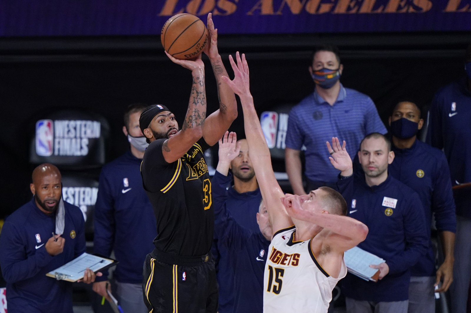 Los Angeles Lakers' Anthony Davis shoots a 3-point basket over Denver Nuggets' Nikola Jokic at the end of an NBA playoff game in Lake Buena Vista, Florida, Sept. 20, 2020. (AP Photo)