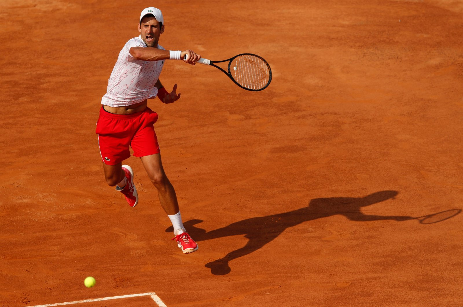 Novak Djokovic plays a forehand to Casper Ruud during their semifinal match at the Italian Open, in Rome, Italy, Sept. 20, 2020. (AFP Photo)