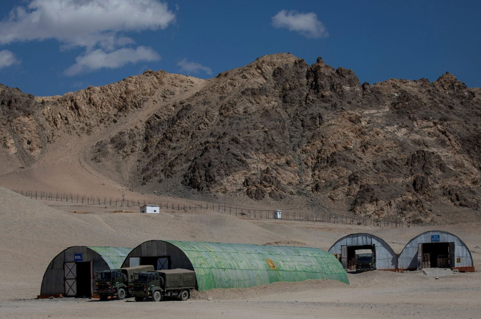 Military trucks are parked outside the storage facilities at a supply depot in Leh, in the Indian-controlled Ladakh region, Sept. 15, 2020. (REUTERS Photo)