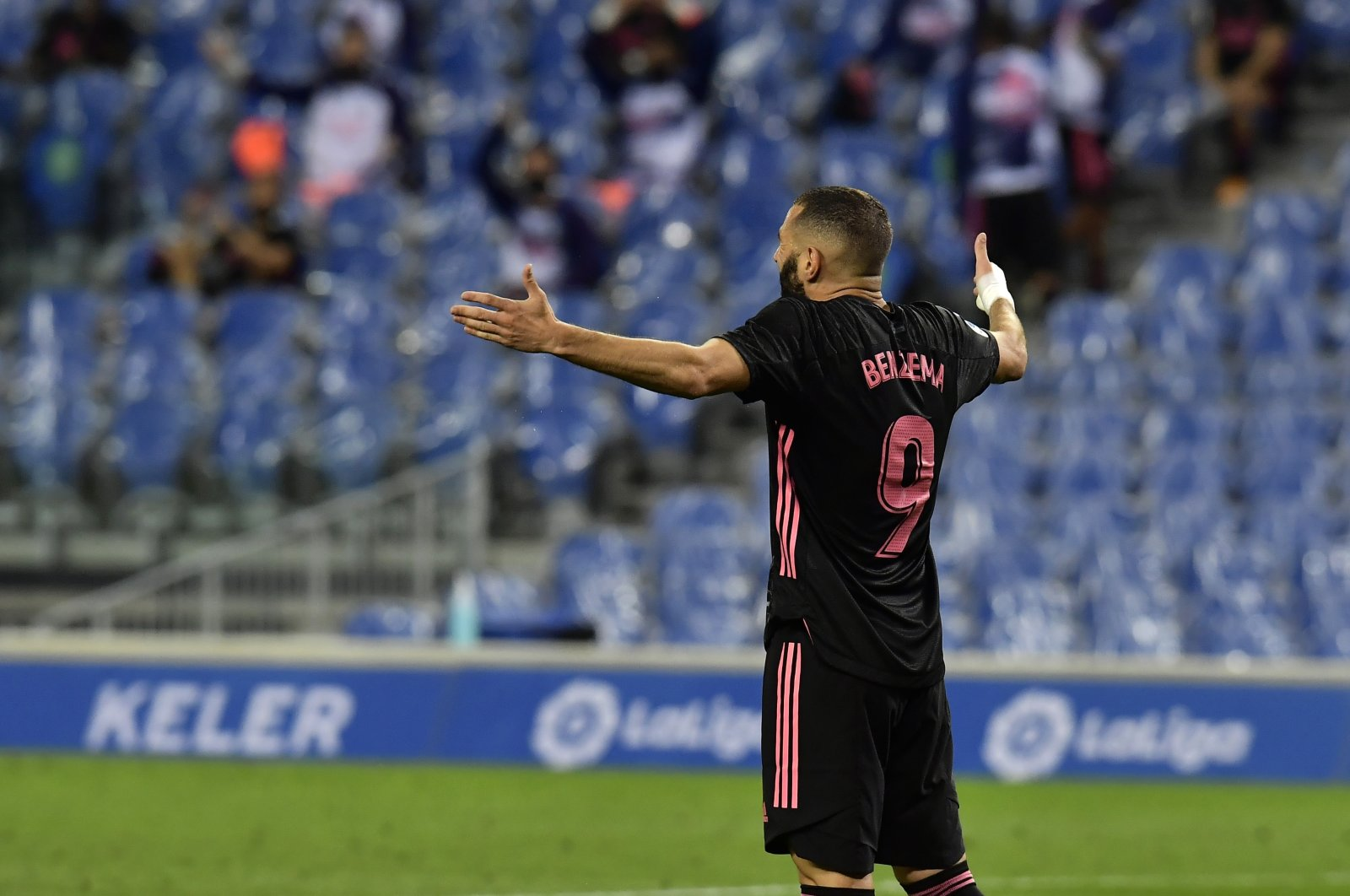 Real Madrid's Karim Benzema reacts during a La Liga match against Real Sociedad, in San Sebastian, Spain, Sept. 20, 2020. (AP Photo)