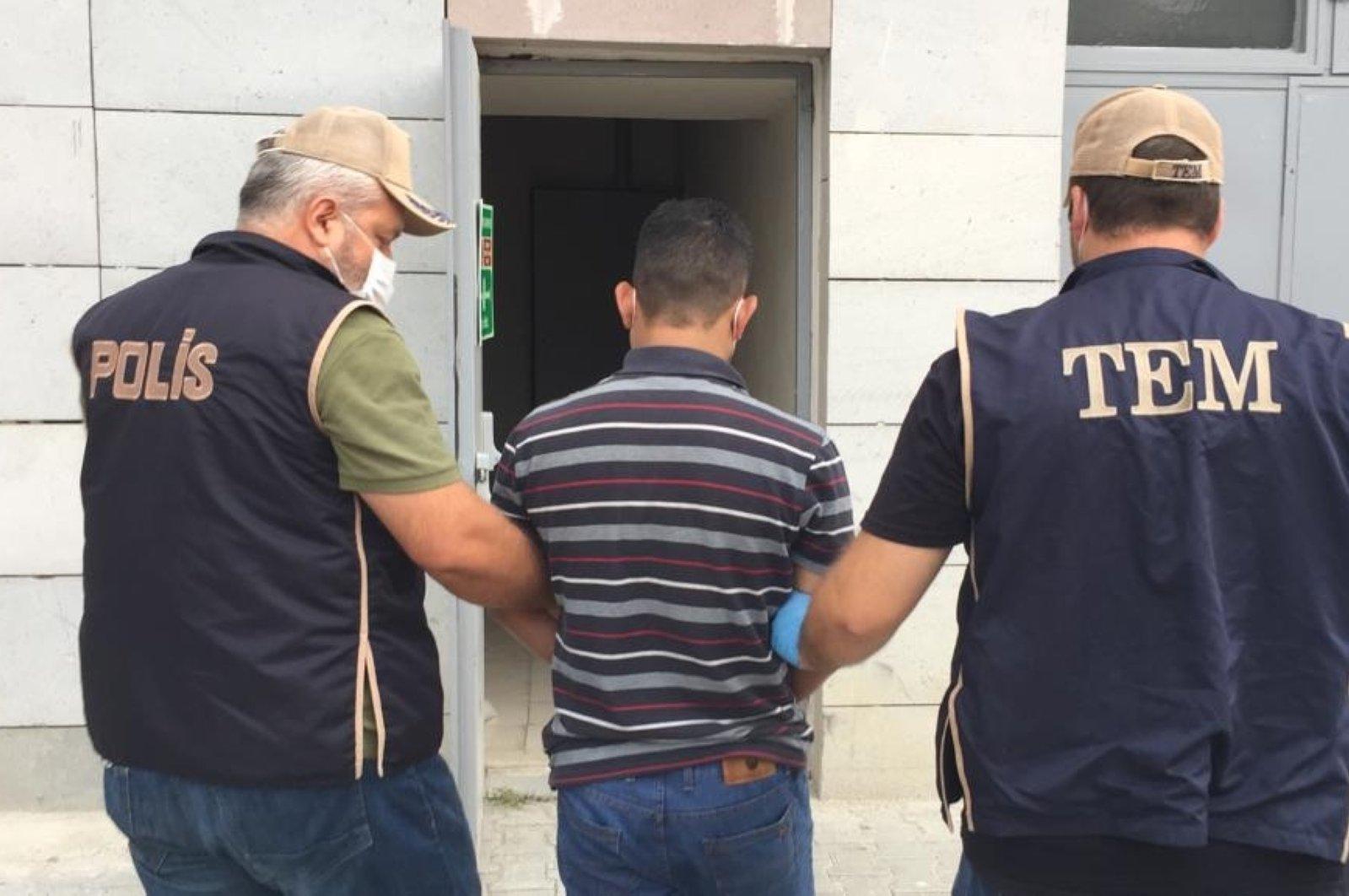 Counterterrorism police bring suspected Daesh terrorist to the police station in Samsun, Turkey on Monday, Sept. 21, 2020 (DHA Photo)