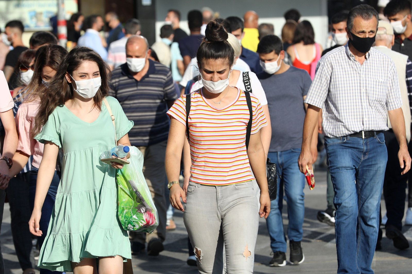 People wear protective face masks while walking along a street in the capital Ankara, Turkey, Sept. 18, 2020. (AFP Photo)