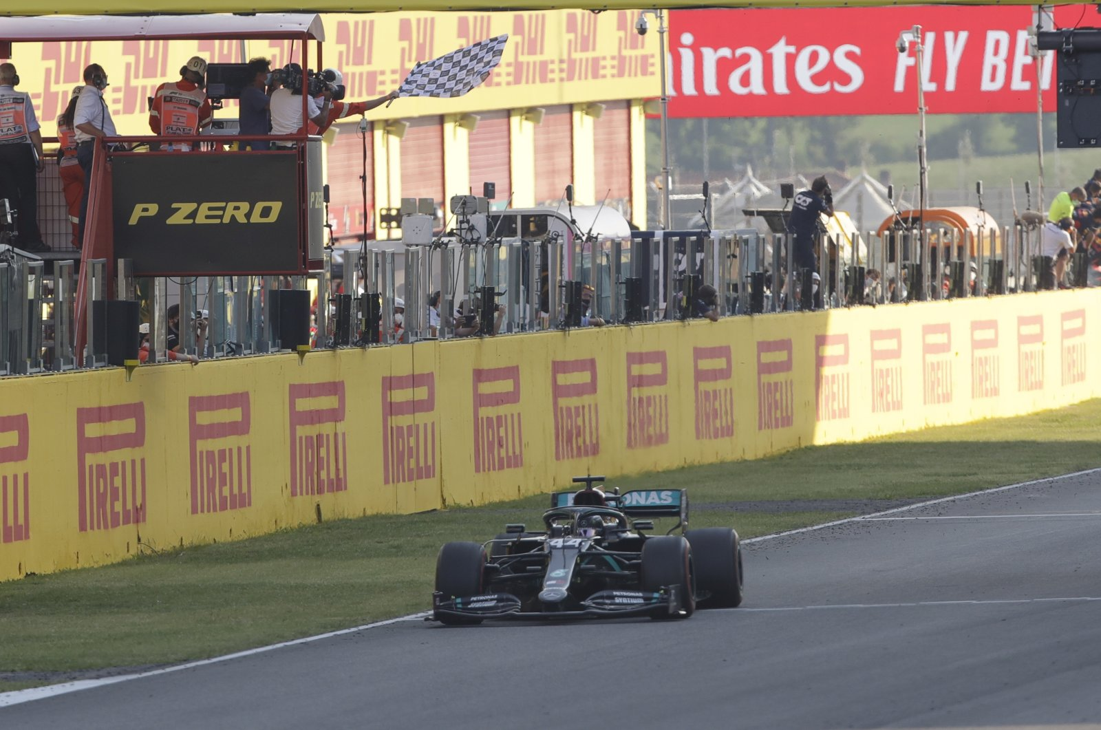 Mercedes driver Lewis Hamilton gets the checkered flag to win the Formula 1 Tuscany GP, in Scarperia, Italy, Sept. 13, 2020. (AP Photo)