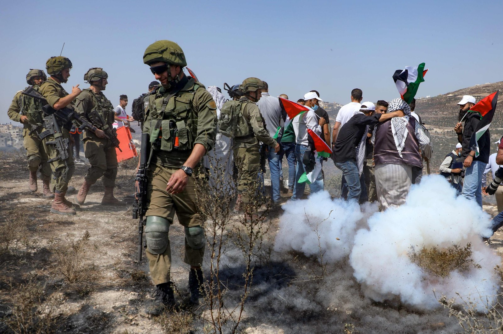 Israeli security forces intervene as Palestinians protest against Jewish settlements and the normalization of ties with two Arab states in Asira al-Qibliya in the Israeli-occupied West Bank, Palestine, Sept. 18, 2020. (AFP Photo)