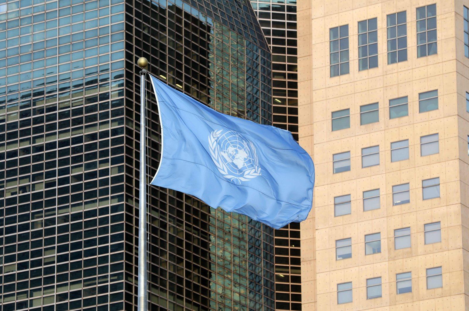 The United Nations flag waves near U.N. headquarters in New York, Sept. 23, 2019. (AFP Photo)