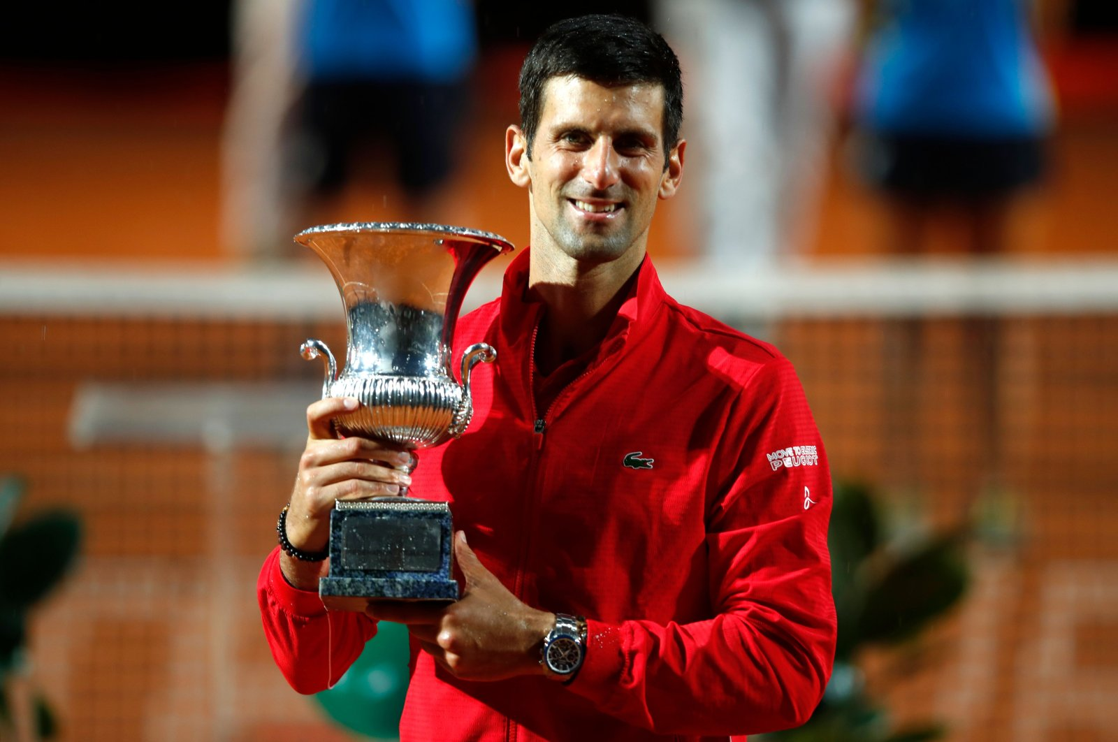 Novak Djokovic of Serbia poses with his trophy after winning the final match of the Men's Italian Open against Argentina's Diego Schwartzman at Foro Italico, in Rome, Italy, Sept. 21, 2020. (AFP Photo)