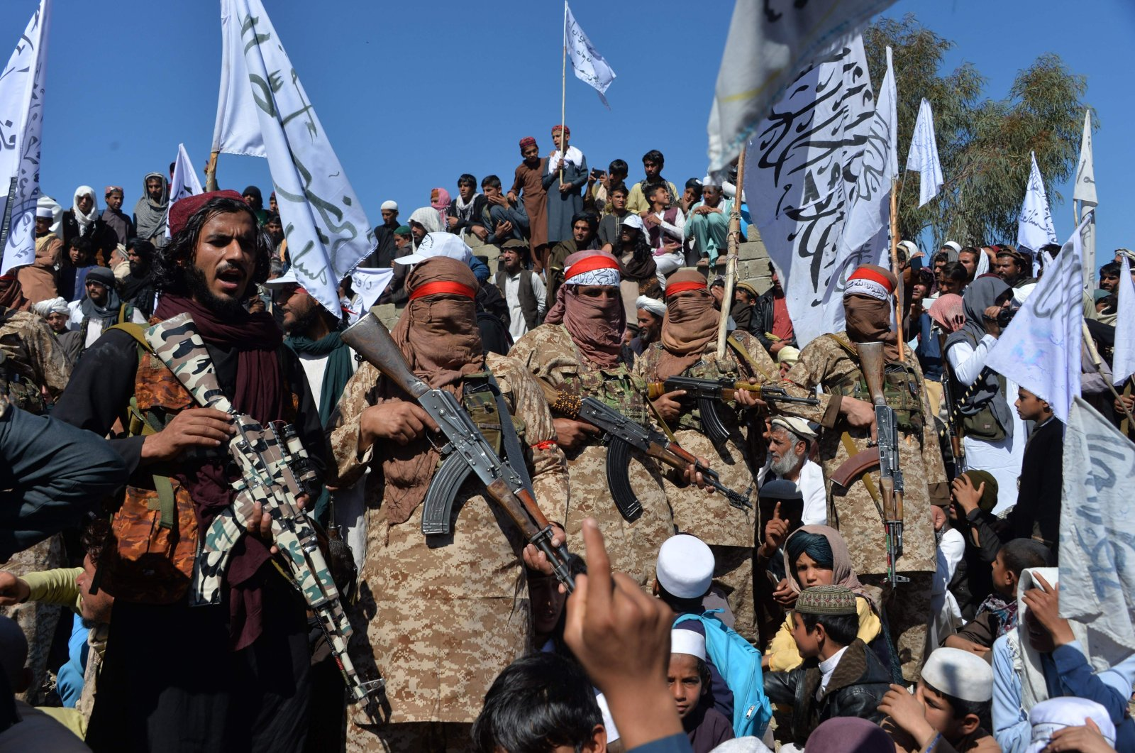 Afghan Taliban militants and villagers attend a gathering as they celebrate the peace deal and their victory in the Afghan conflict, in the Alingar district of Laghman province, Afghanistan, March 2, 2020. (AFP Photo)