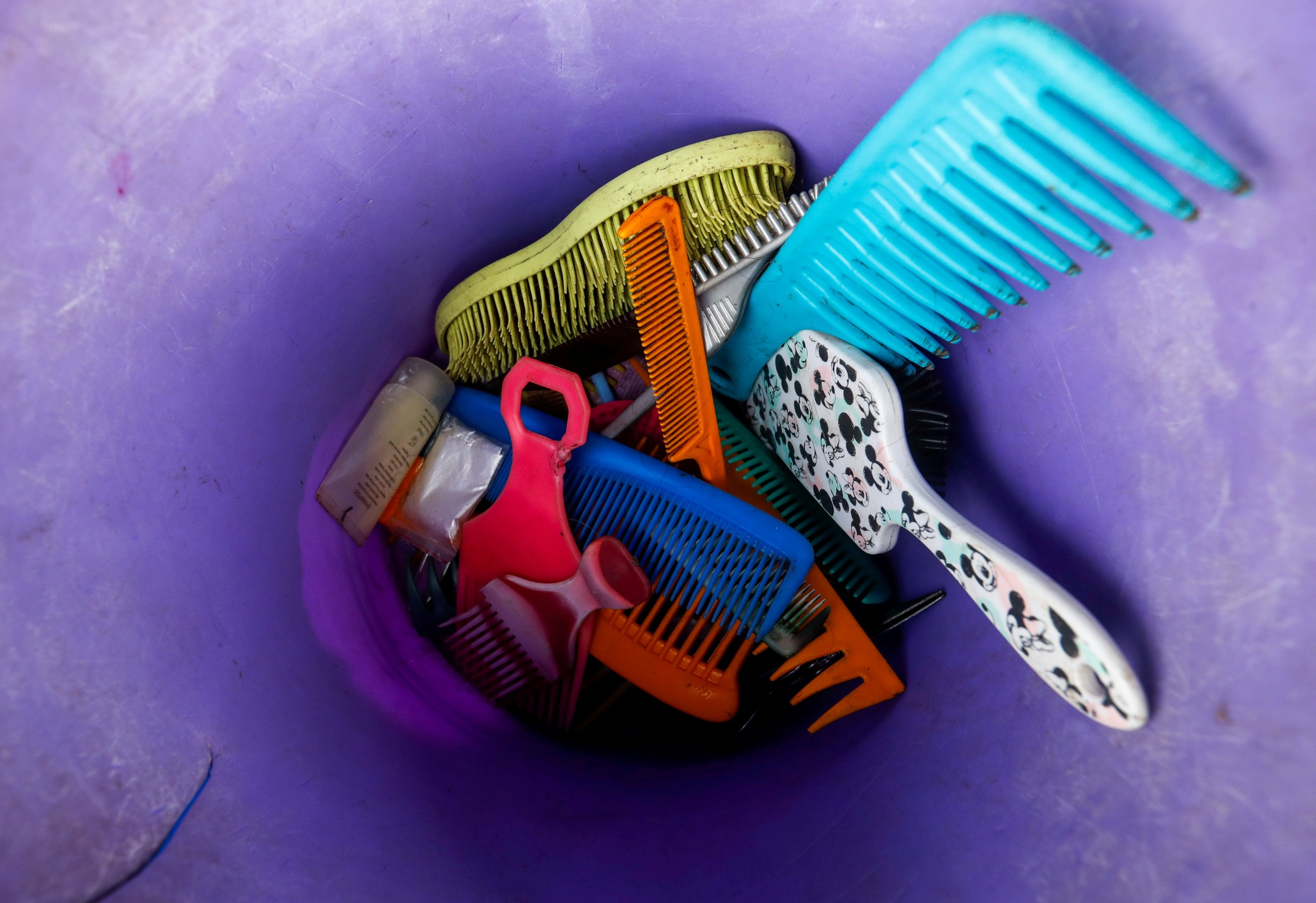 Combs and brushes are seen at a makeshift hair salon near the Dandora dumpsite, amid the COVID-19 outbreak in Eastlands Nairobi, Kenya, July 29, 2020. (REUTERS Photo)