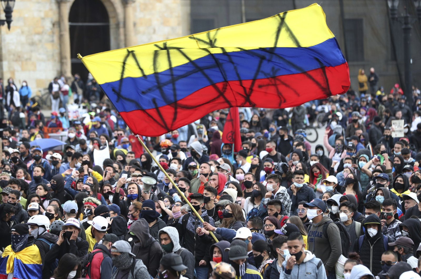 Protesters gather at Bolivar Square during a protest against the government in Bogota, Colombia, Sept. 21, 2020. (AP Photo)