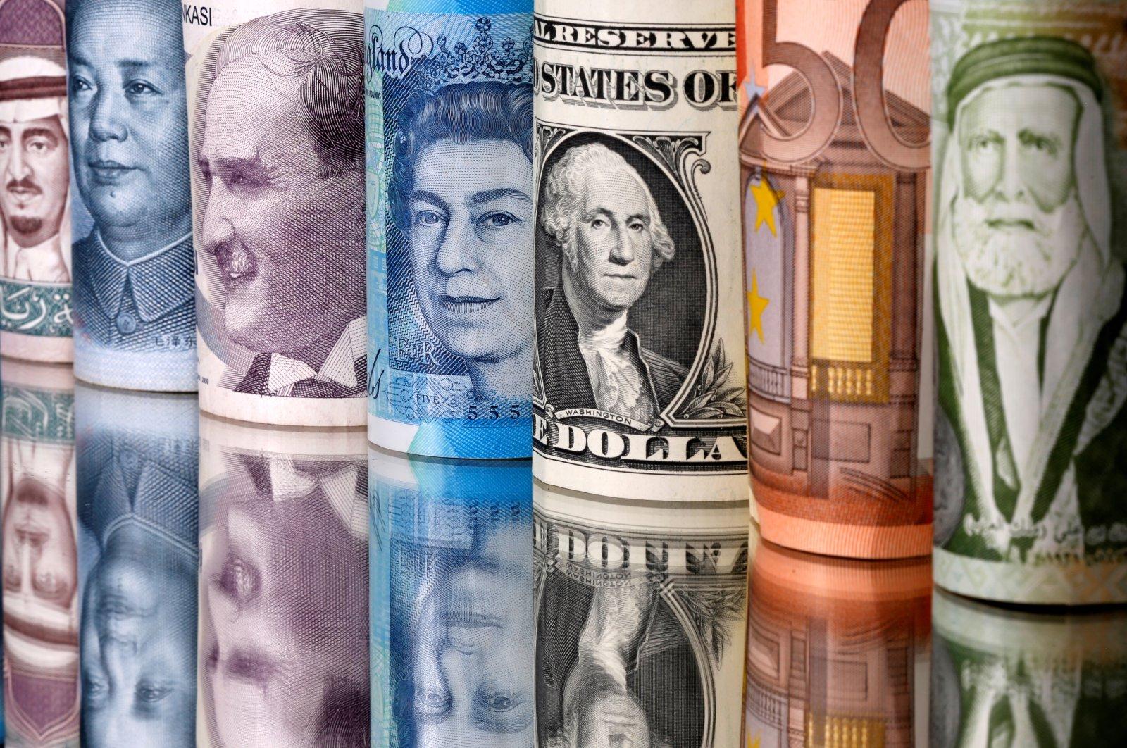 (From L to R) Saudi riyal, Chinese yuan, Turkish lira, British pound, U.S. dollar, euro and Jordanian dinar banknotes are seen in this illustration, Jan. 6, 2020. (Reuters Photo)