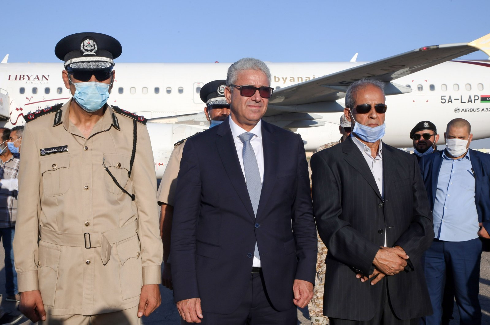 Libya's Interior Minister Fathi Bachagha (C) poses for a picture upon his arrival at Mitiga International Airport, east of the capital Tripoli, Libya, Aug. 29, 2020. (AFP Photo)