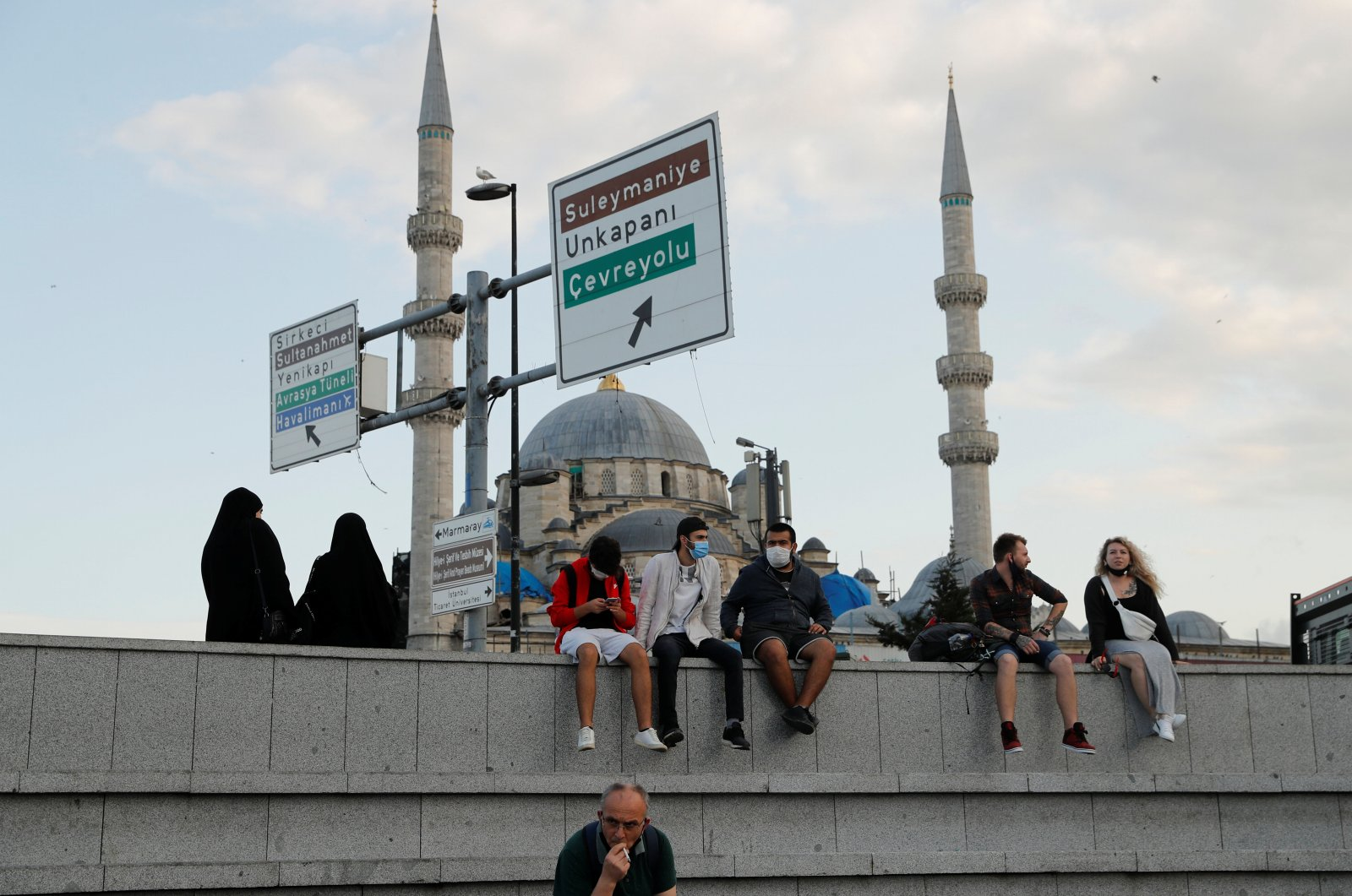 People wearing protective face masks rest near the Eminönü pier, in Istanbul, Turkey, Sept. 21, 2020. (Reuters Photo)