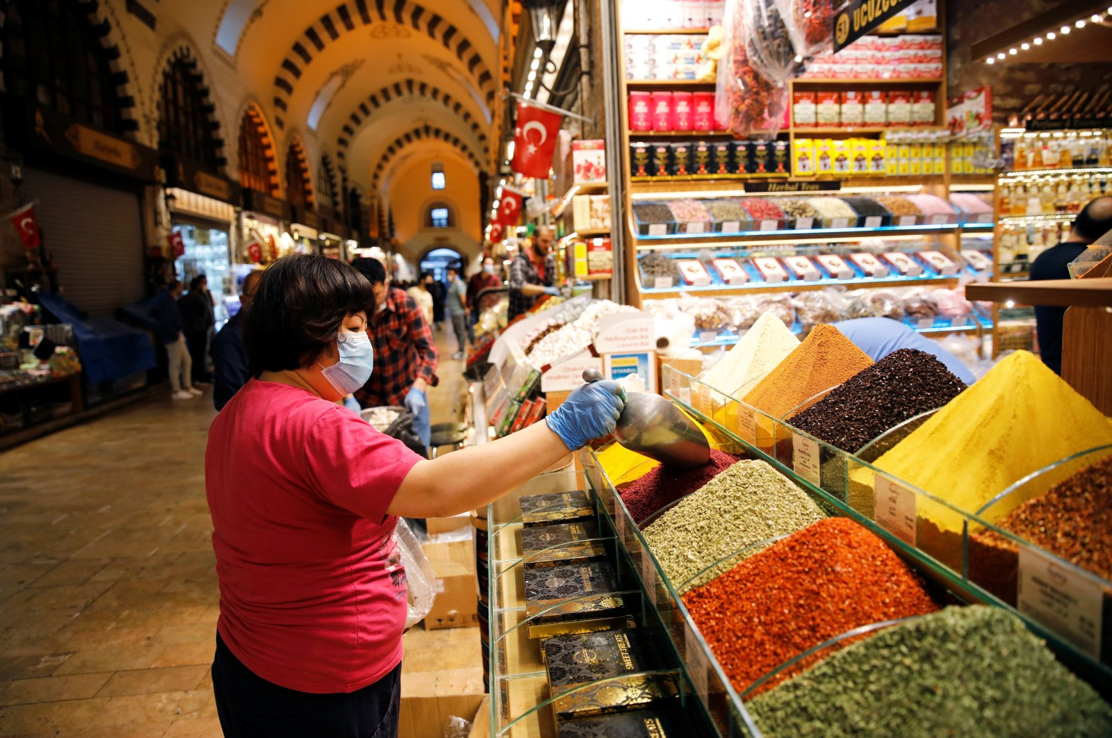 A vendor adds spice at a stall at the spice market, also known as the Egyptian Bazaar, as it reopened after weeks of closed doors amid the spread of COVID-19, Istanbul, Turkey, June 1, 2020. (Reuters Photo)