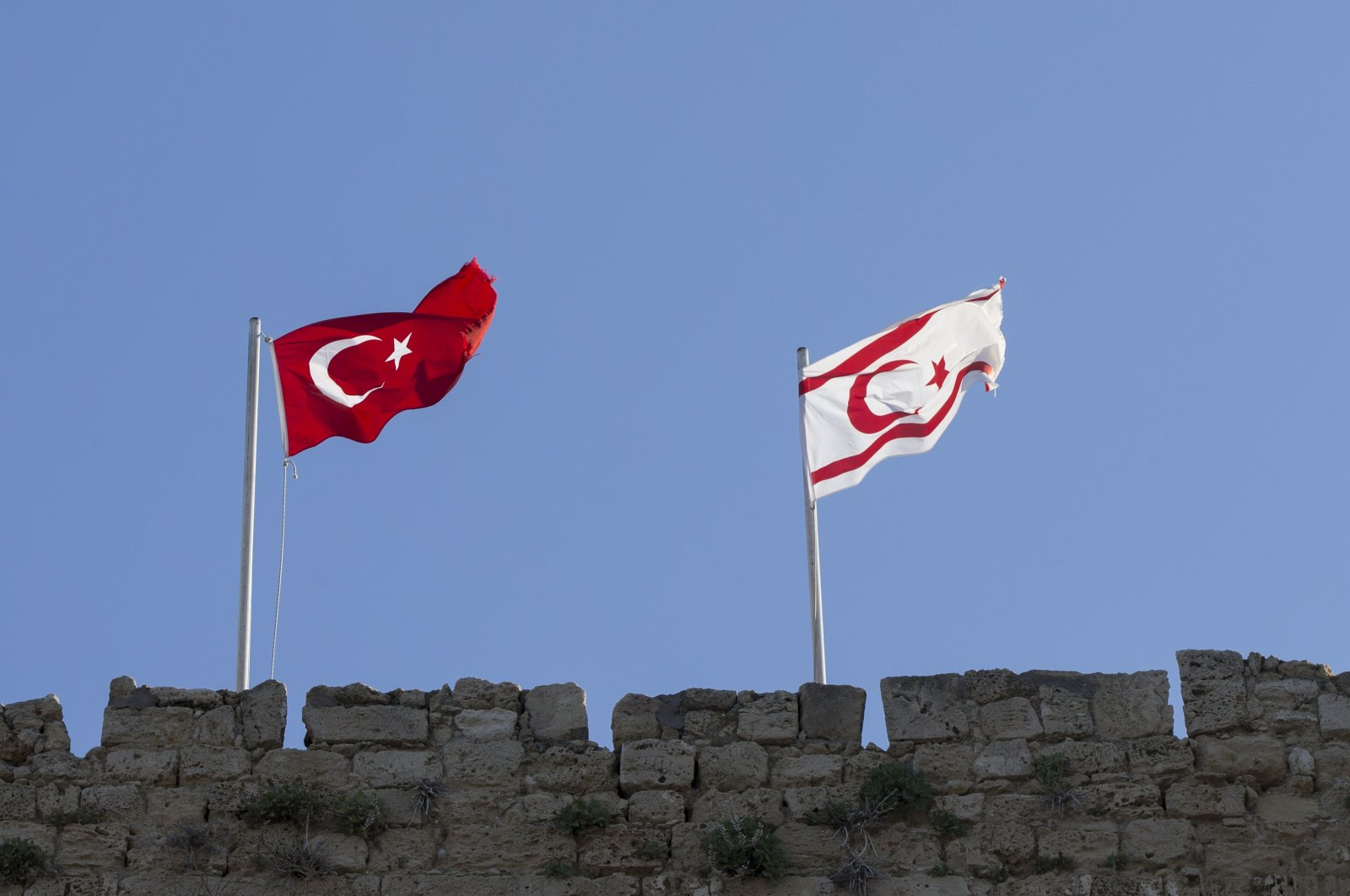 Turkish and Turkish Republic of Northern Cyprus (TRNC) flags wave side by side in this undated photo. (AA File Photo)