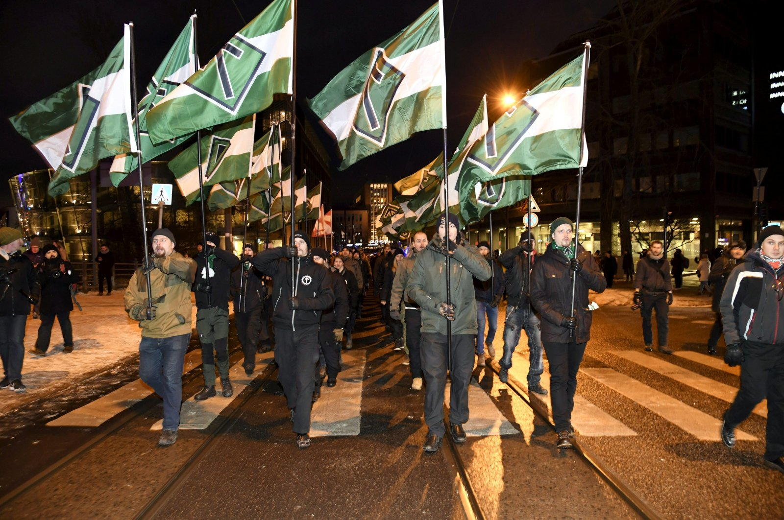 Members of the far-right group Nordic Resistance Movement march during the festivities of the centenary of Finnish independence, Helsinki, Dec. 6, 2017. (REUTERS Photo)