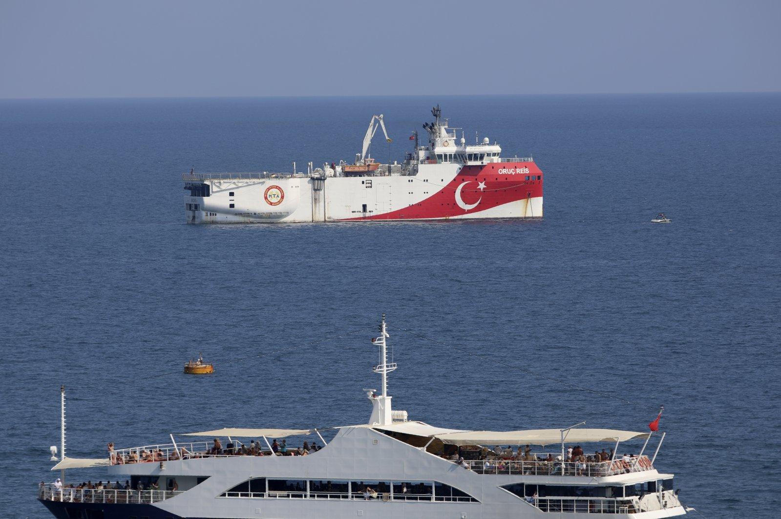 Turkey's research vessel Oruç Reis, rear, anchored off the coast of Antalya, southern Turkey, in the Mediterranean, Sept. 13, 2020. (AP Photo)
