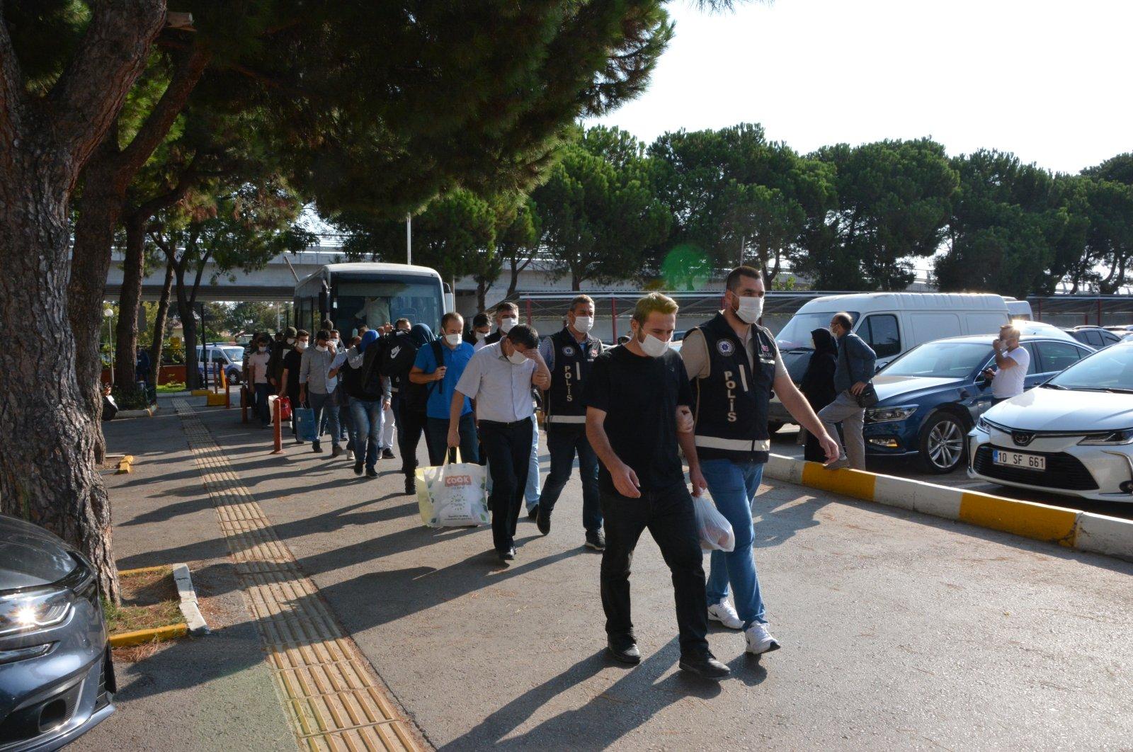 Police escort FETÖ suspects to the courthouse, in Balıkesir, western Turkey, Sept. 22, 2020. (AA Photo)