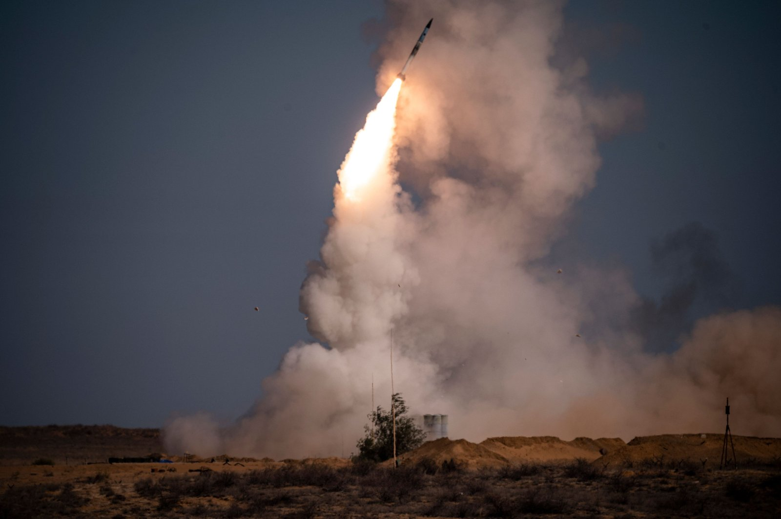 "A rocket launches from a S-400 missile system at the Ashuluk military base in Southern Russia on September 22, 2020 during the ""Caucasus-2020"" military drills gathering China, Iran, Pakistan and Myanmar troops, along with ex-Soviet Armenia, Azerbaijan and Belarus. (AFP Photo)"