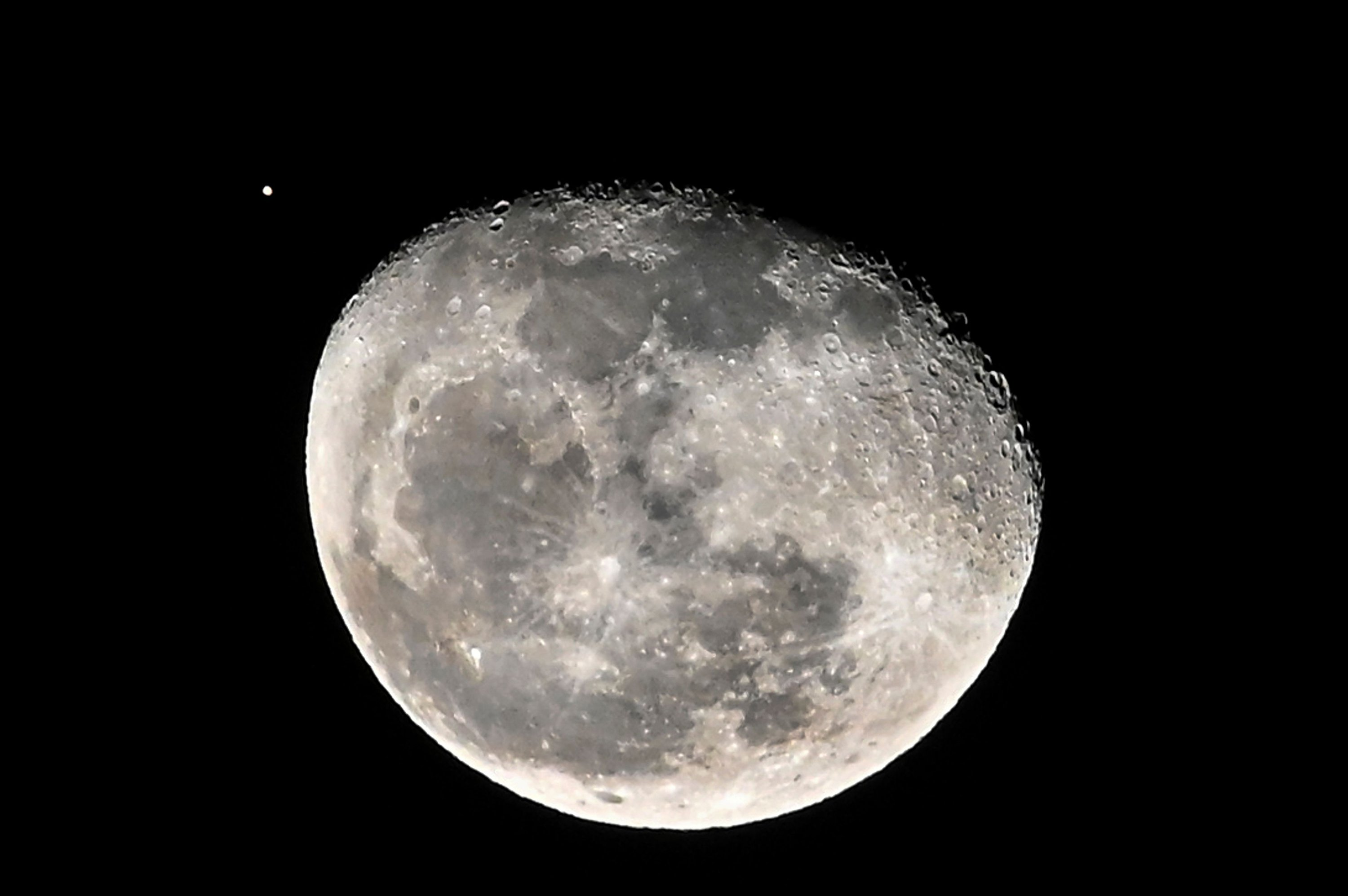 The moon is seen alongside planet Mars in Cali, Colombia, on Sept. 5, 2020. (AFP Photo)