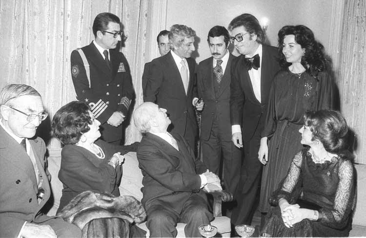 Then-President Fahri Korutürk and his wife Emek Korutürk (seated) speak with Zeki Müren and actress Fatma Girik at a reception held for journalists and artists on Feb. 14, 1978, at Çankaya Mansion, Ankara, Turkey. (AA PHOTO)