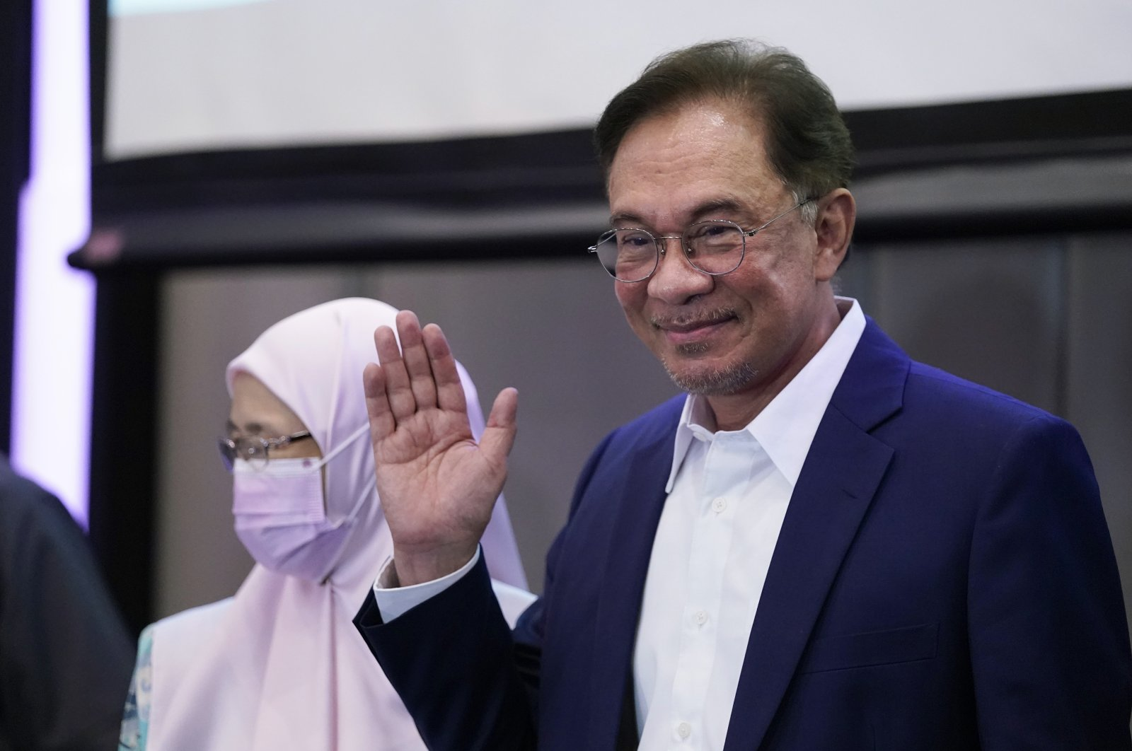 Malaysia's opposition leader Anwar Ibrahim waves after a press conference in Kuala Lumpur, Sept. 23, 2020. (AP Photo)