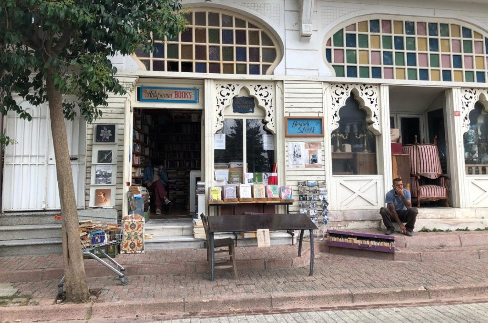 The exterior of the bookstore, decorated with oriental elements and stained colorful glass. (Photo by Matt Hanson)