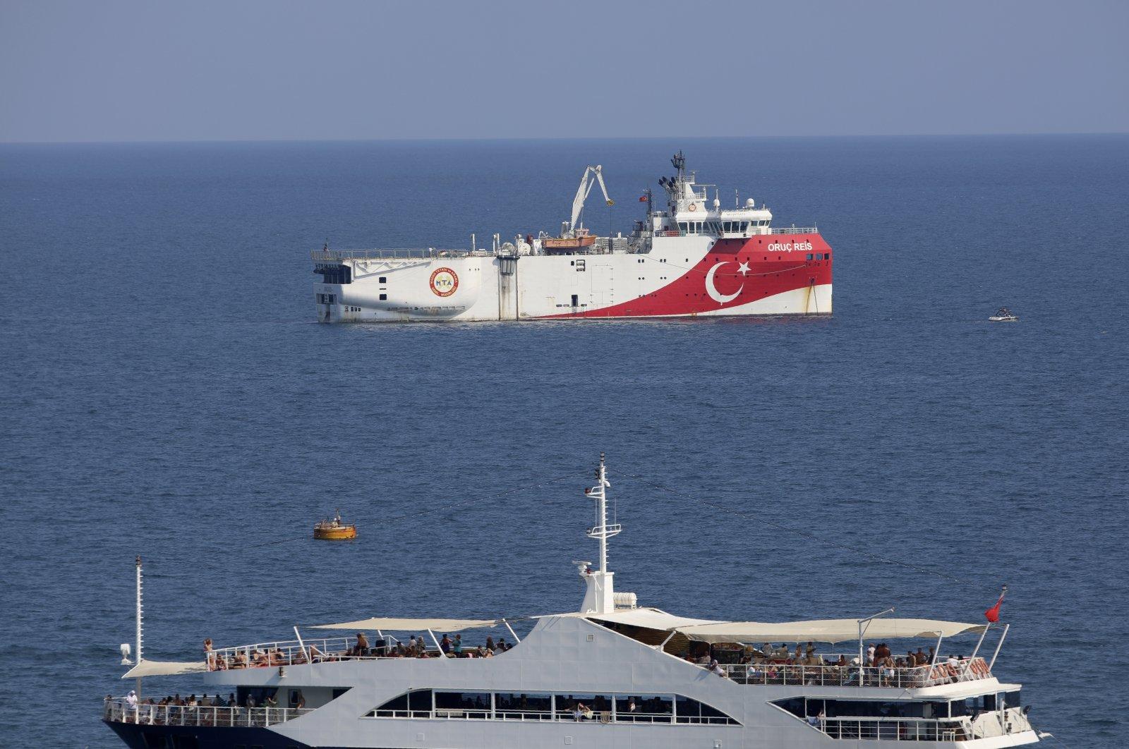 Turkey's research vessel, Oruç Reis (rear) anchored off the coast of Antalya on the Mediterranean Sea, southwestern Turkey, Sept. 13, 2020. (AP Photo)