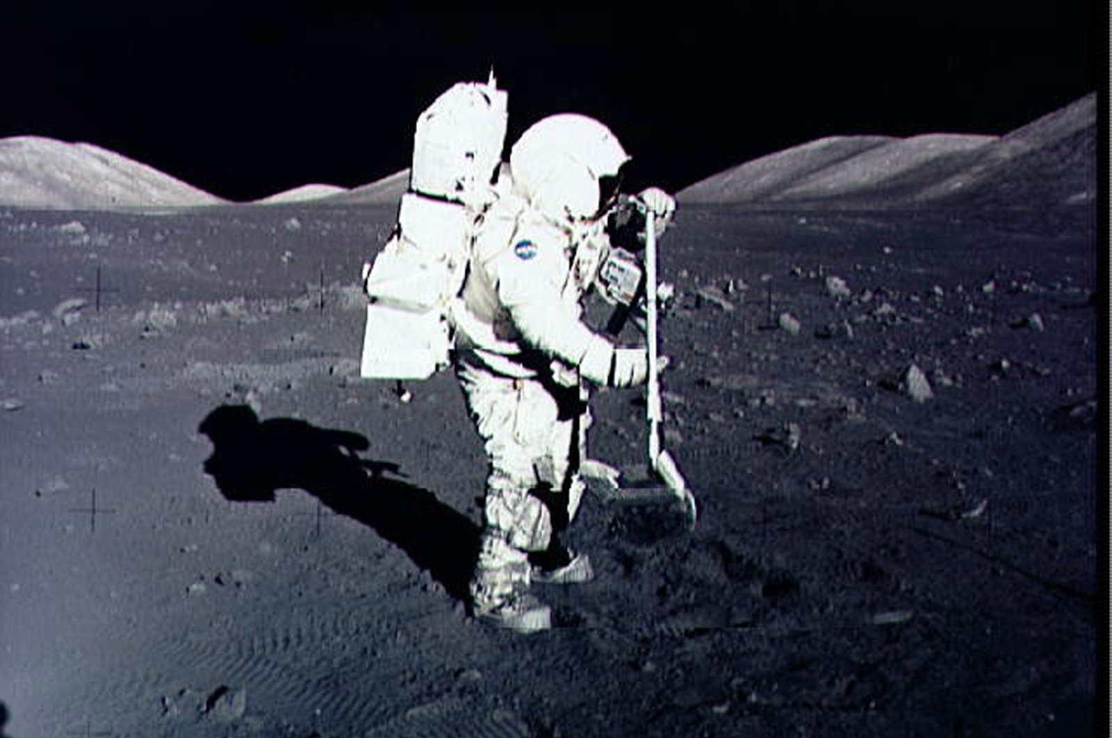 Astronaut Harrison Schmitt collects lunar rock samples at the Taurus-Littrow landing site on the moon during the Apollo 17 mission, Dec. 10, 1972. (NASA Handout Photo via AFP)