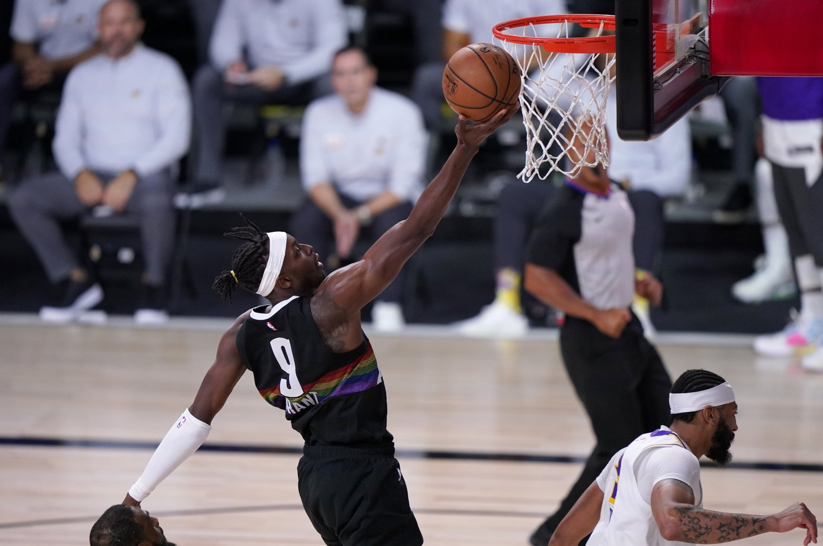 Denver Nuggets forward Jerami Grant (9) goes up for a shot over Los Angeles Lakers' Anthony Davis during the Game 3 of the NBA basketball Western Conference final, in Lake Buena Vista, U.S., Sept. 22, 2020. (AP Photo)