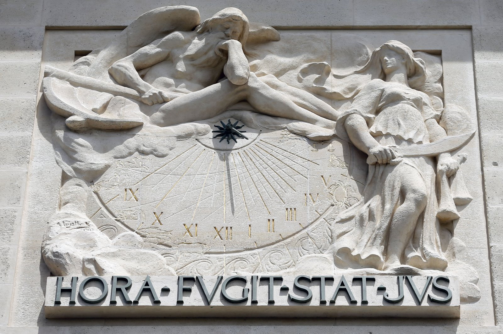 """The iconic exterior sculpture at the Palais de Justice – a French palace that houses the Court of Appeal of Paris and the French Court of Cassation – declares its motto: """"HORA FUGIT STAT JUS,"""" meaning """"the hour passes, justice remains"""" in Paris, June 13, 2017. (Photo by Getty Images)"""