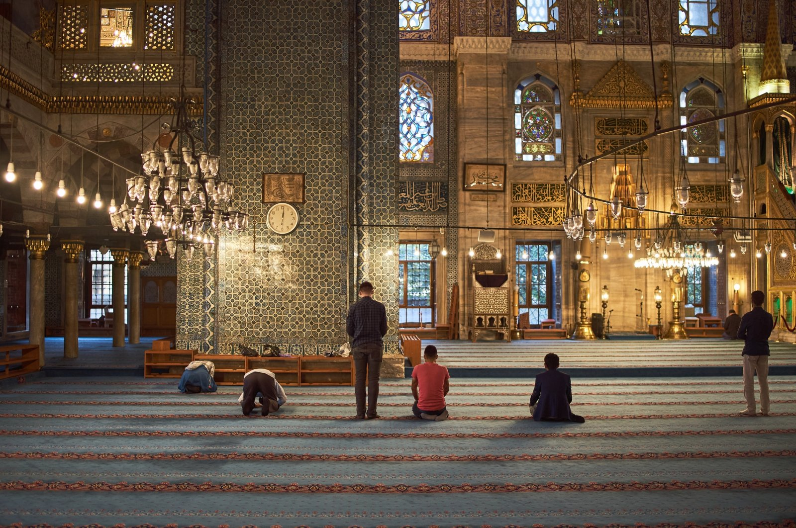 Muslim people pray at the iconic Yeni Cami mosque, which was built by the orders of Safiye Sultan and Hatice Turhan Sultan, in Istanbul. (iStock Photo)