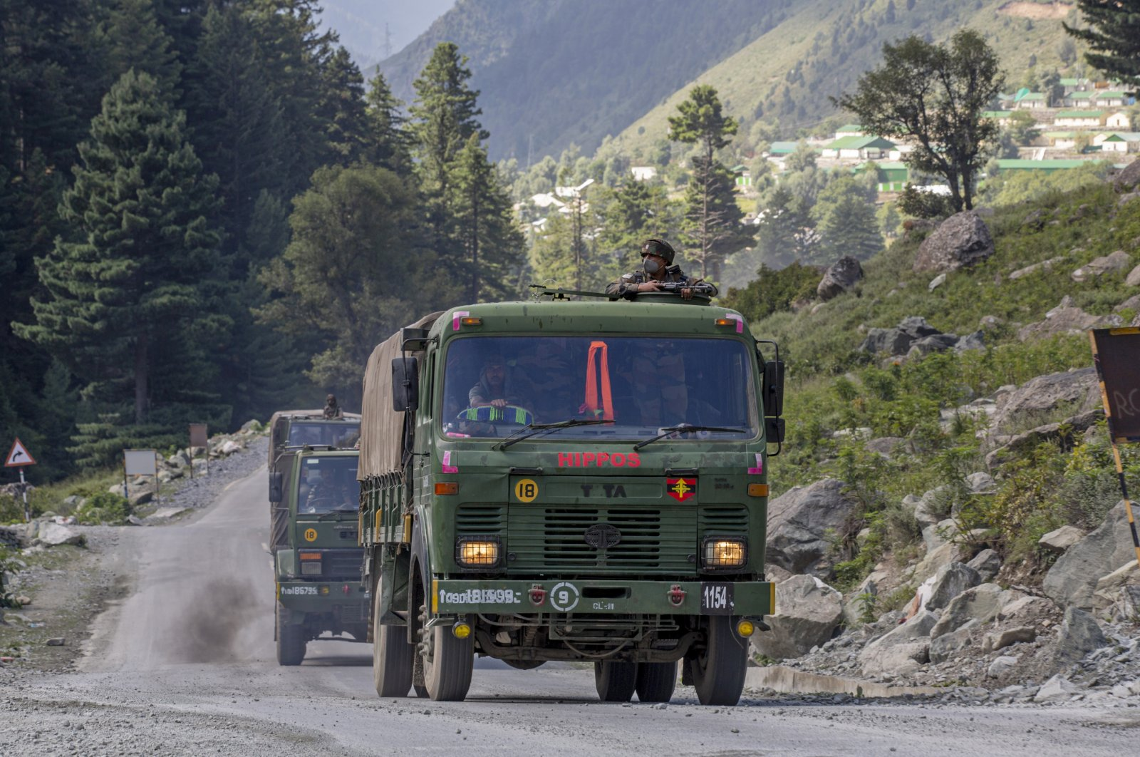 An Indian army convoy moves on the Srinagar-Ladakh highway at Gagangeer, northeast of Srinagar, Kashmir, Sept. 9, 2020. (AP Photo)