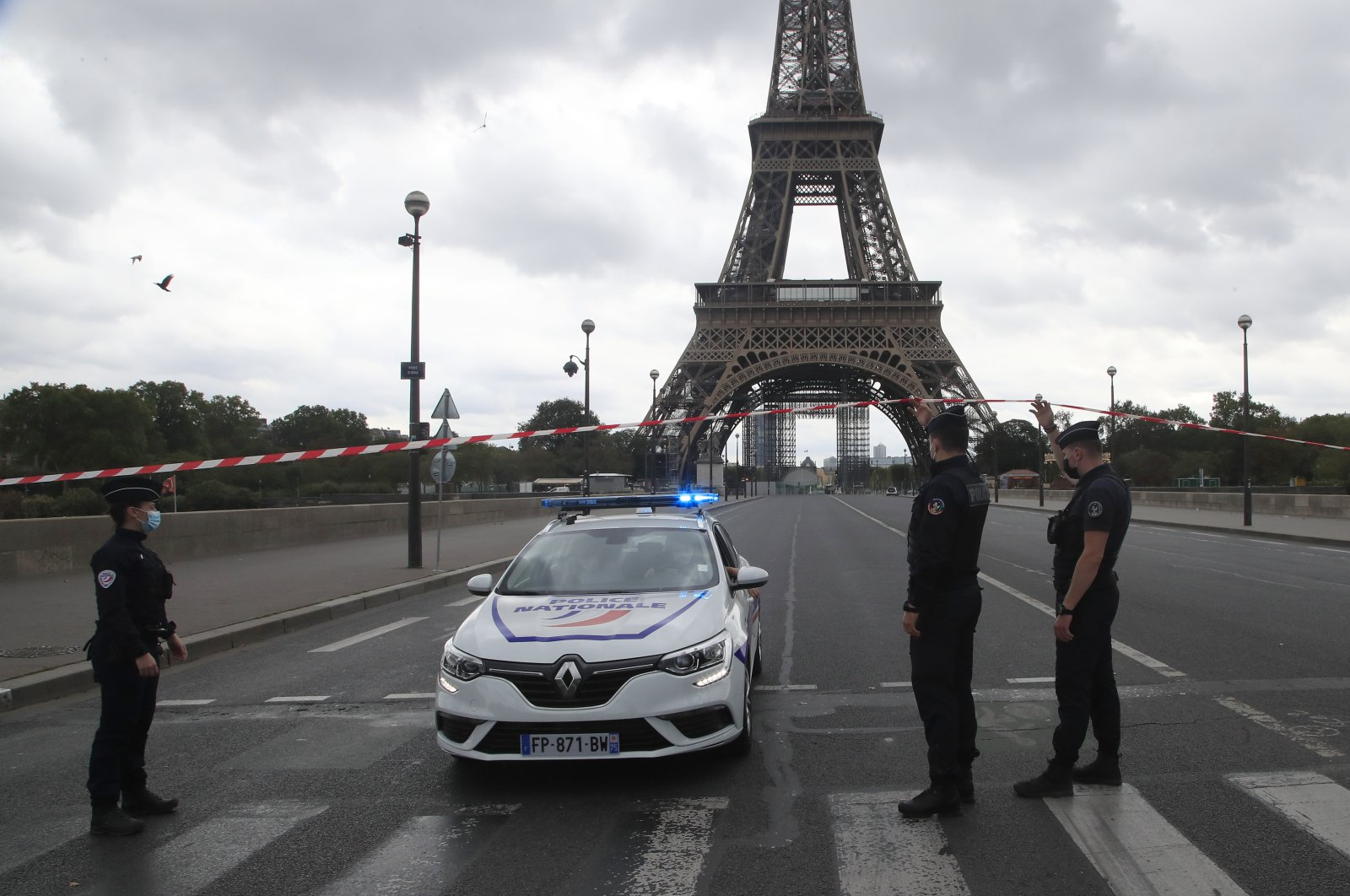 French police officers secure the bridge leading to the Eiffel Tower, Wednesday, Sept. 23, 2020 in Paris. (AP Photo)