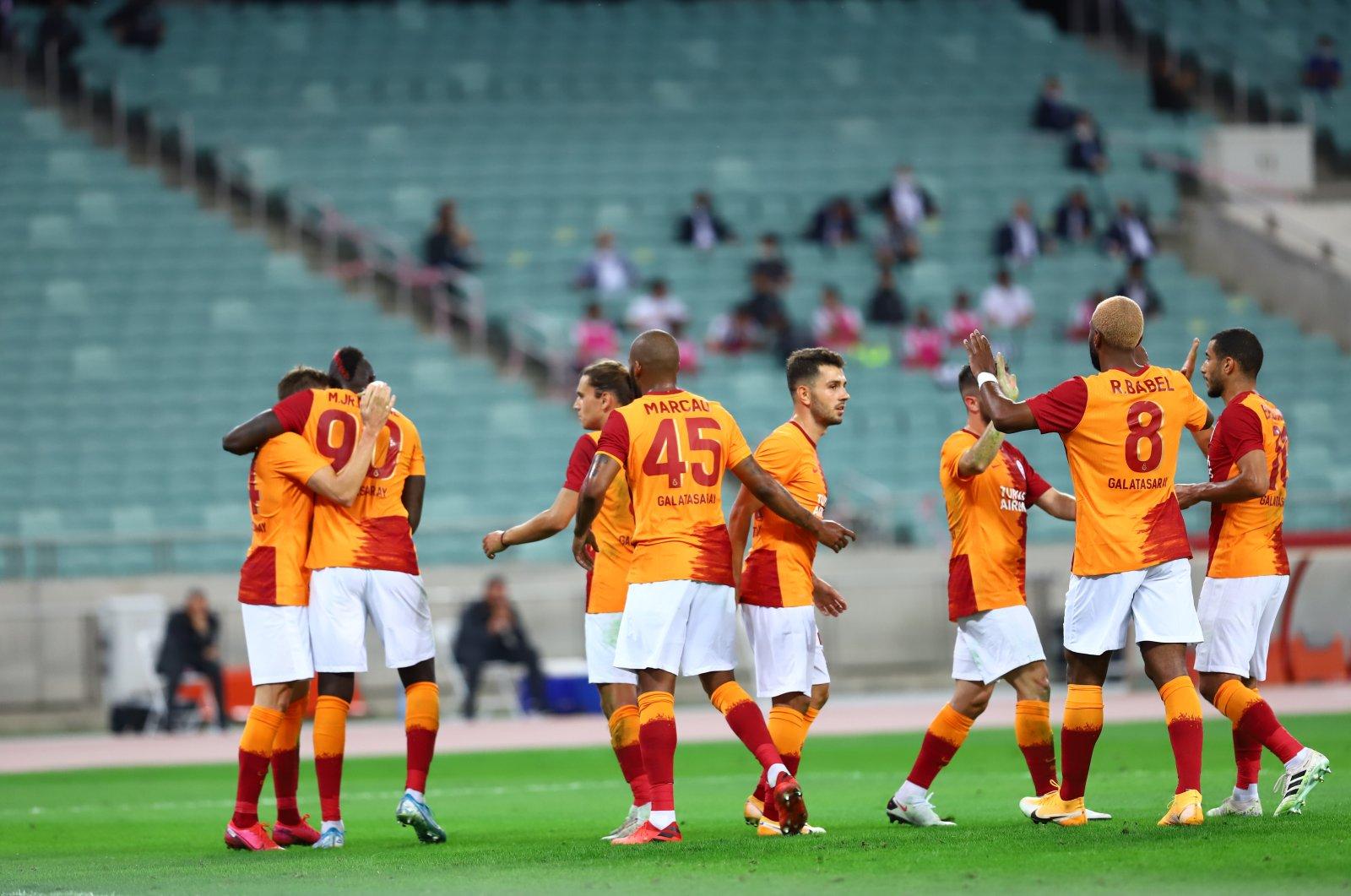 Galatasaray players celebrate a goal against Neftçi during a Europa League match in Baku, Azerbaijan, Sept. 17, 2020. (AA Photo)