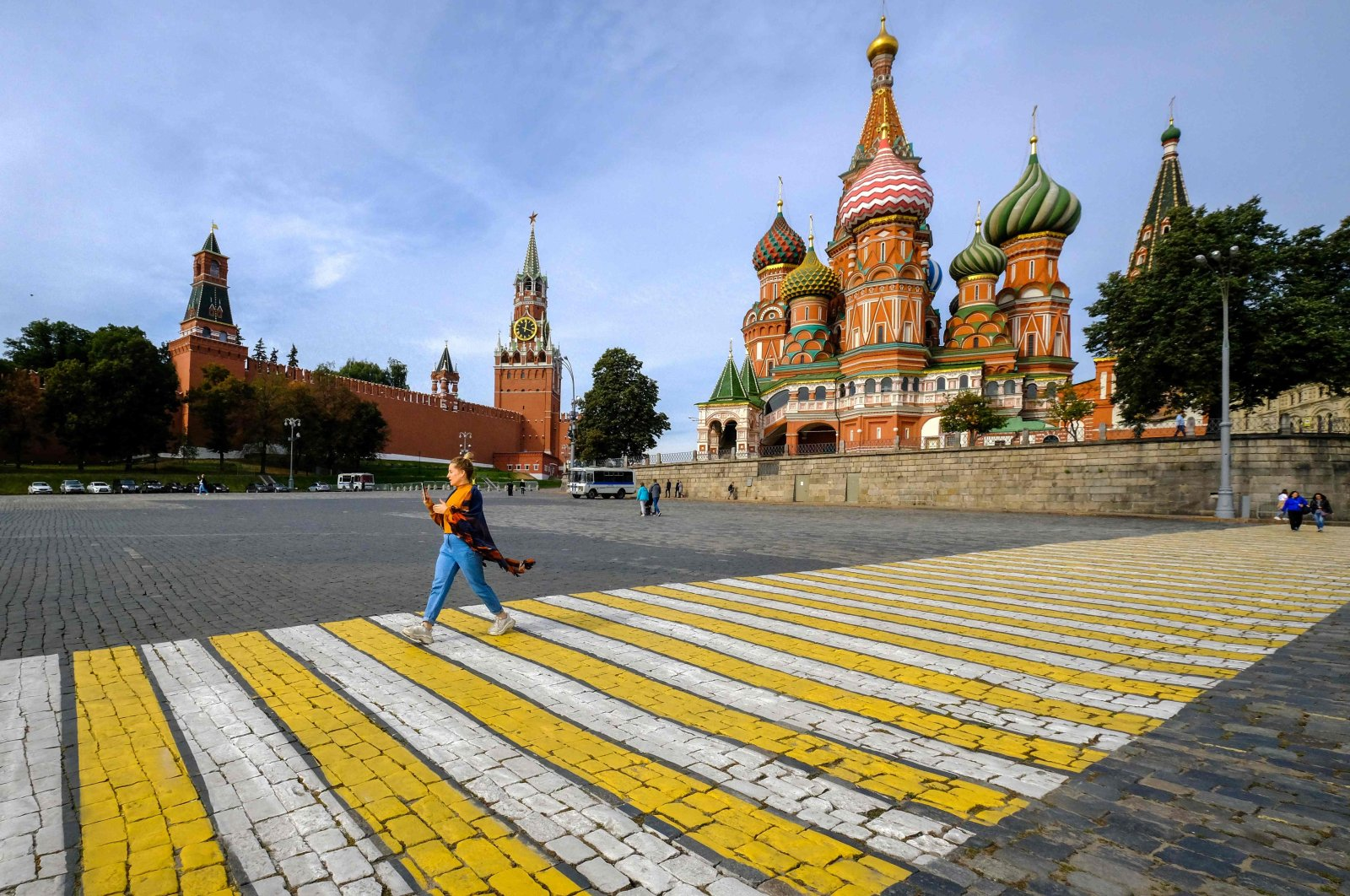 A woman walks along a crosswalk near St. Basil's Cathedral in central Moscow, Sept. 17, 2020. (AFP Photo)