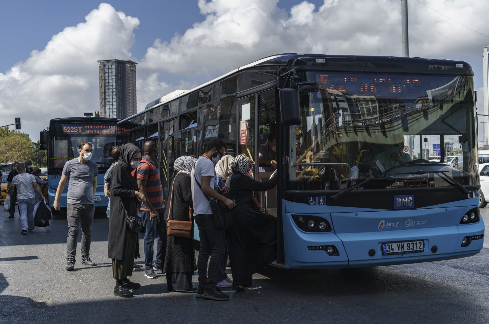 People in Istanbul get on a Turkish-made BMC bus, which is used in public transportation by the Istanbul Metropolitan Municipality, on Sept. 8, 2020. (DHA Photo)